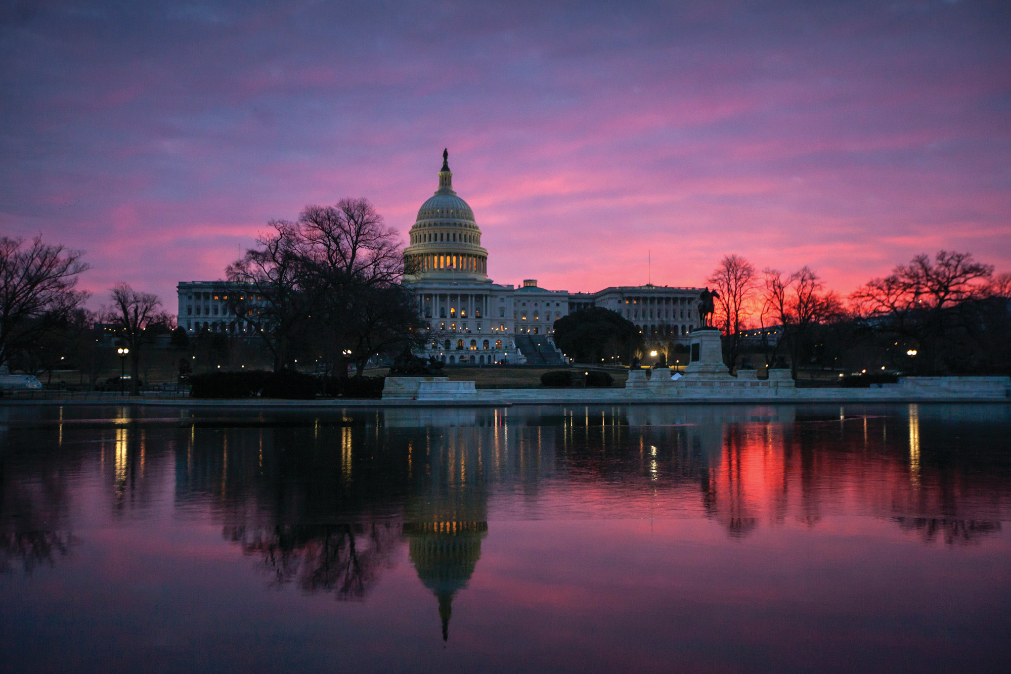 Dawn breaks over the Capitol in Washington on Feb. 6. The once-bipartisan drive to curb increases in health care premiums has devolved into a partisan struggle with escalating demands by each side.