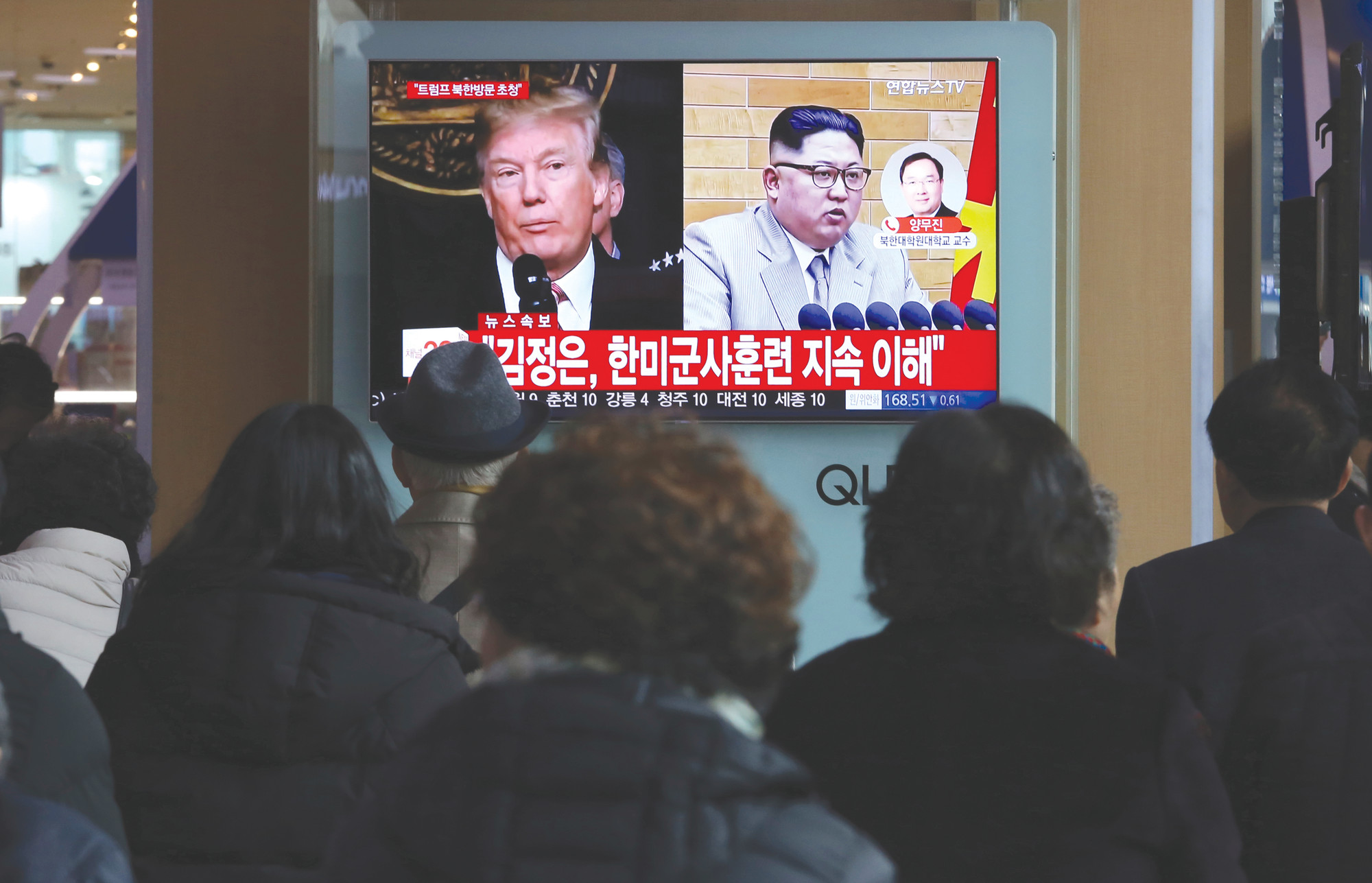 People watch a TV screen showing North Korean leader Kim Jong Un and U.S. President Donald Trump, left, at the Seoul Railway Station in Seoul, South Korea, on Friday. After months of trading insults and threats of nuclear annihilation, Trump agreed to meet with North Korean leader Kim Jung Un by the end of May to negotiate an end to Pyongyang's nuclear weapons program, South Korean and U.S. officials said Thursday.