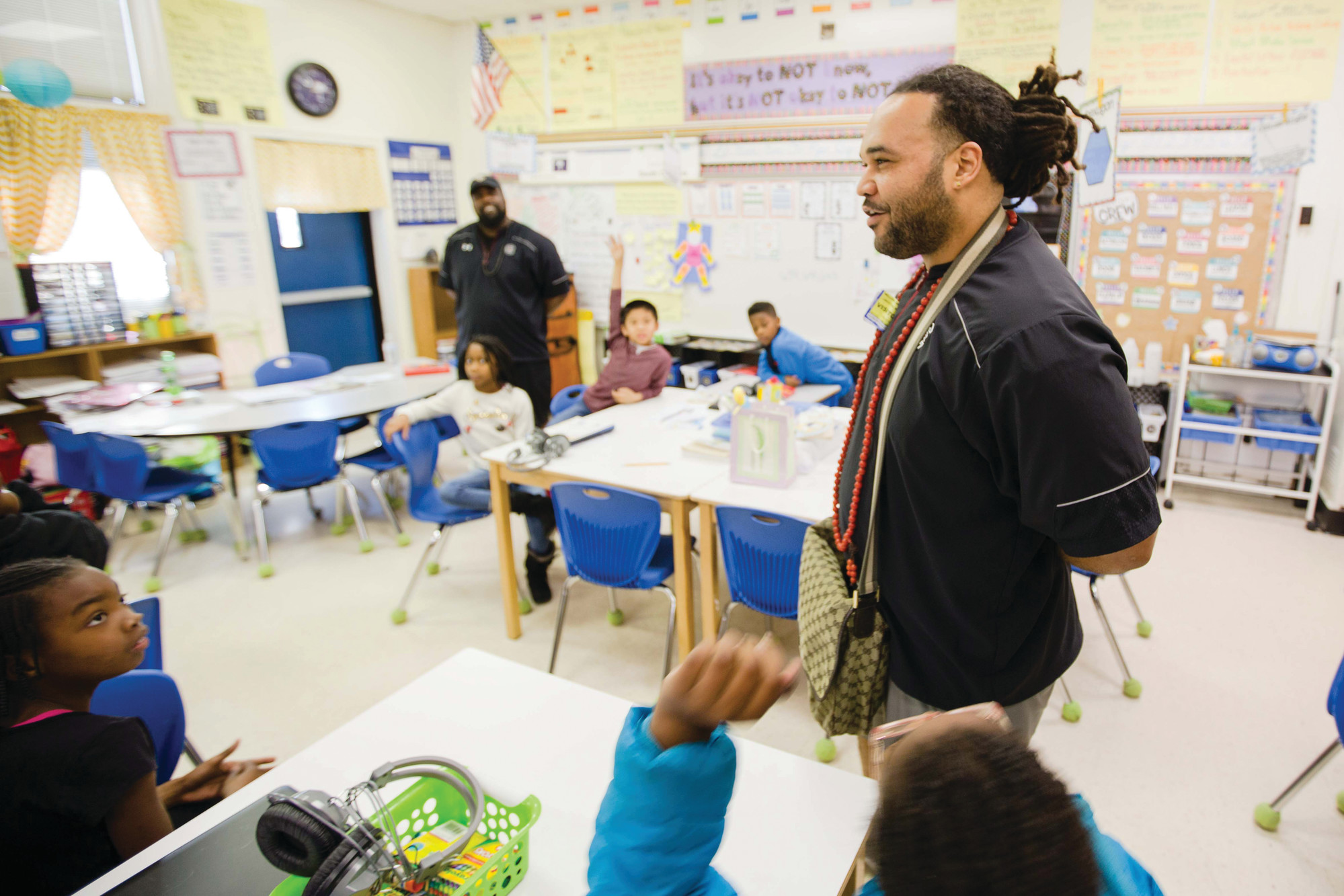 Former USC football player Langston Moore talks to students in a class at Willow Drive Elementary School on Friday. Former teammate Preston Thorne, who co-authored #JustaChicken with Moore, stands in the background.