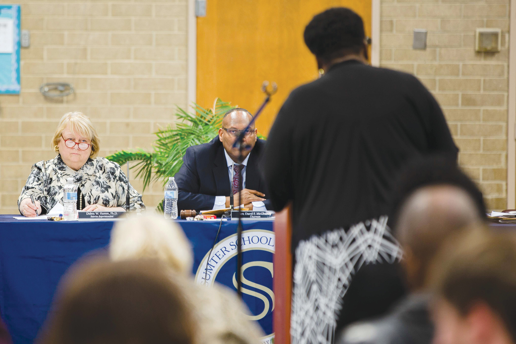 Sumter School District Interim Superintendent Debbie Hamm listens to remarks prior to addressing those in attendance at Sumter High School on Monday.