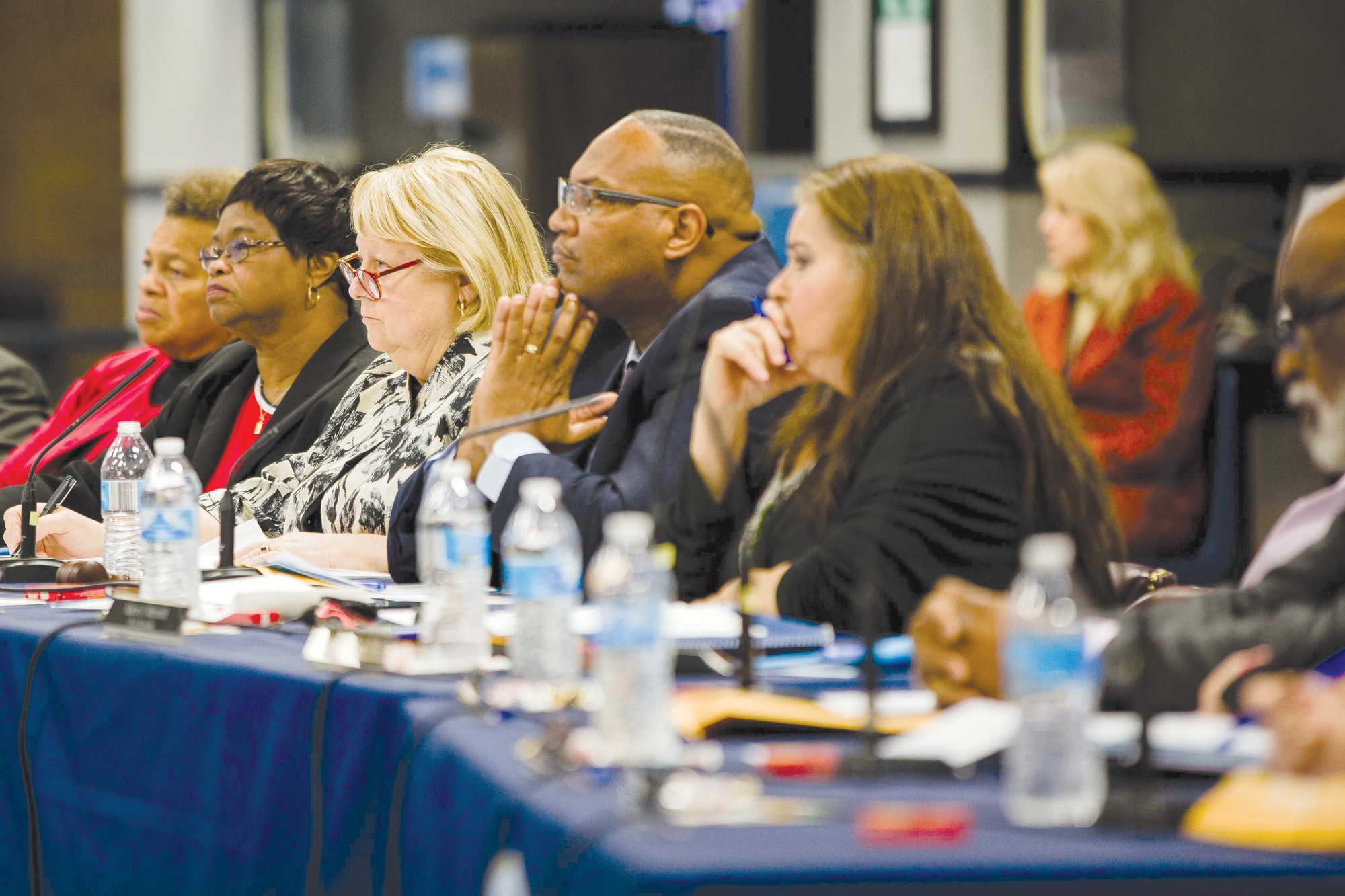 Sumter School District's Board of Trustees and Interim Superintendent Debbie Hamm, center, listen Monday night during public participation at the board meeting at Sumter High School's Commons Area.