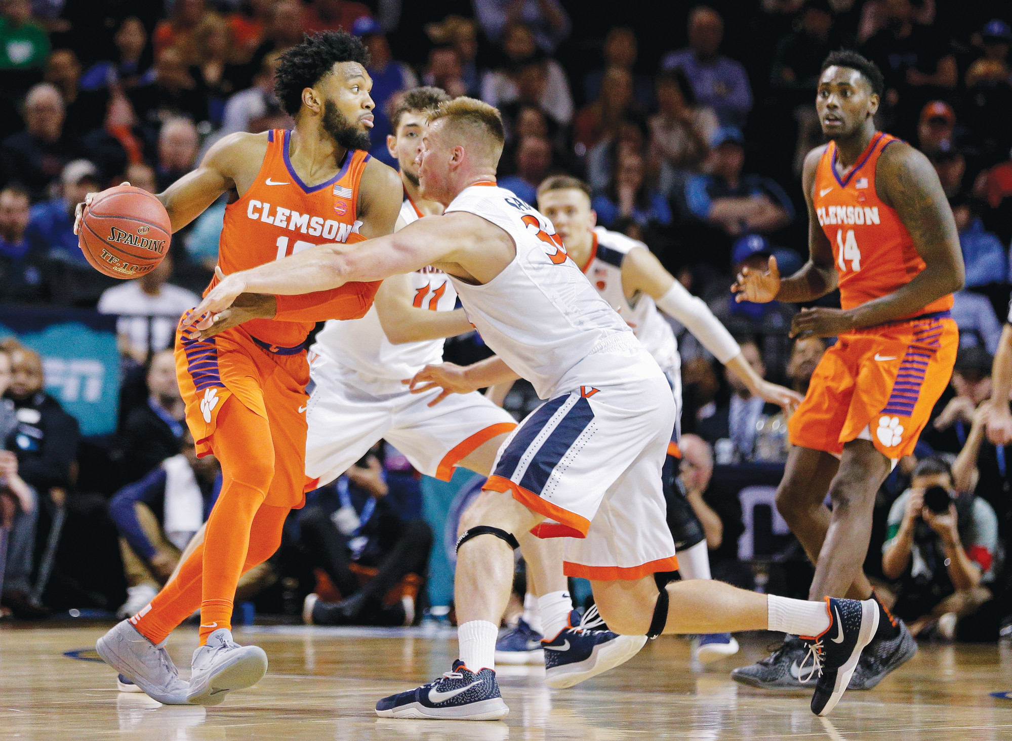 Clemson guard Gabe DeVoe (10) drives against Virginia center Jack Salt (33) during the second half of the Cavaliers' 64-58 victory in an ACC tournament semifinal on Friday in New York. Clemson takes on New Mexico State in the Midwest regional on Friday.