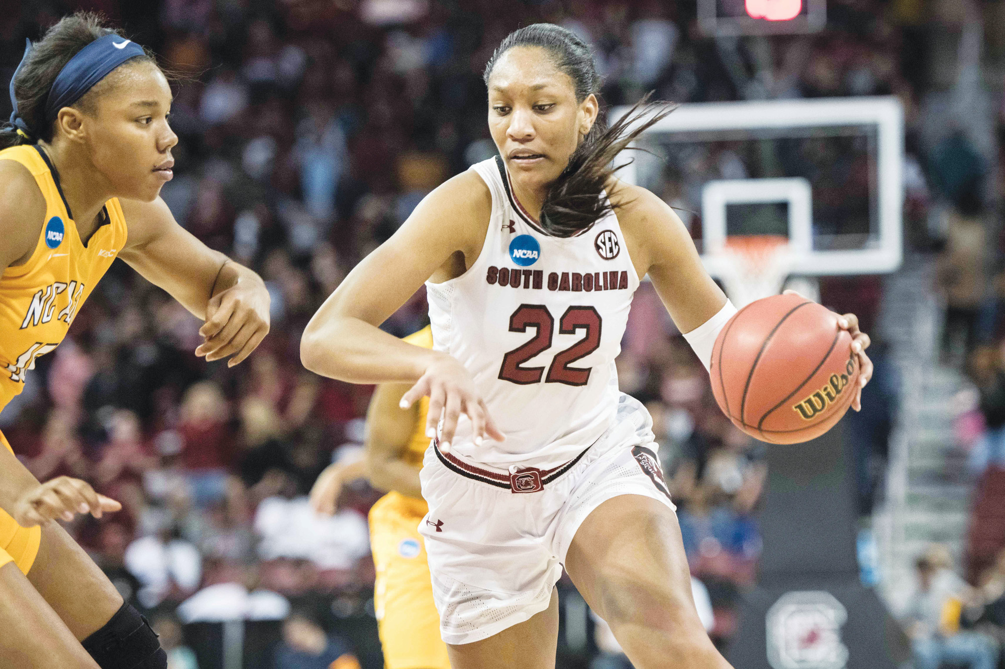 South Carolina forward A'ja Wilson, right,  drives to the hoop against North Carolina A&T forward Alexus Lessears, left, during the second half of a game in the first-round of the NCAA women's college basketball tournament, Friday, March 16, 2018, in Columbia, S.C. South Carolina defeated North Carolina A&T 63-52. (AP Photo/Sean Rayford)