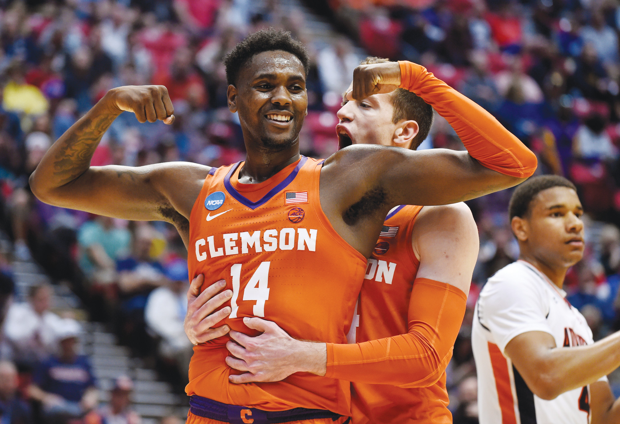 Clemson forward Elijah Thomas (14) celebrates a basket with forward David Skara during the Tigers' 84-53 victory over Auburn on Sunday in the second round of the NCAA tournament in San Diego. Clemson will face No. 1 Kansas on Friday in Omaha, Nebraska, in the Sweet 16.
