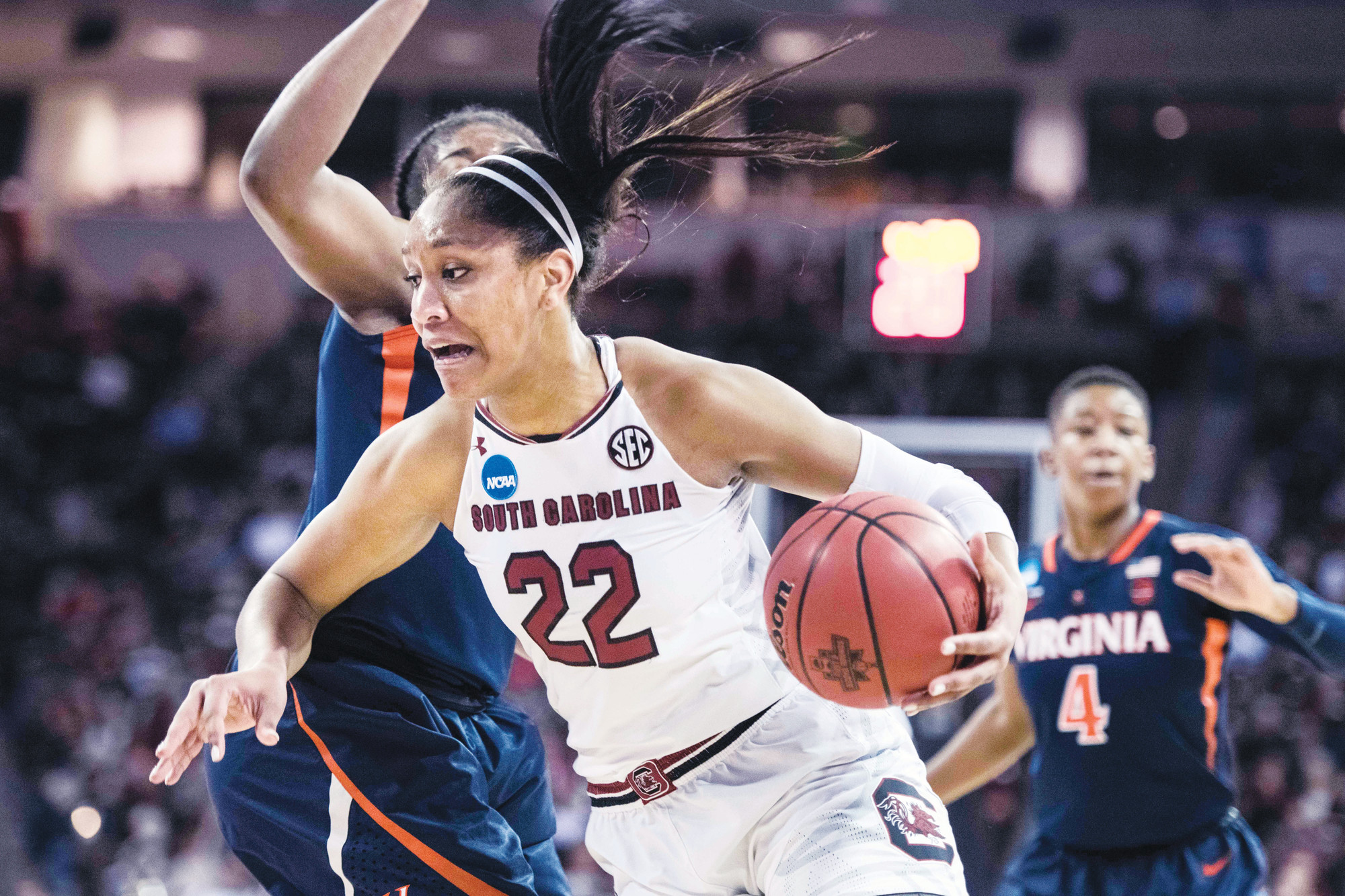 South Carolina forward A'ja Wilson (22) drives to the hoop against Virginia's Jocelyn Willoughby during the Gamecocks' 66-56 win on Sunday in the second round of the women's NCAA tournament in Columbia.