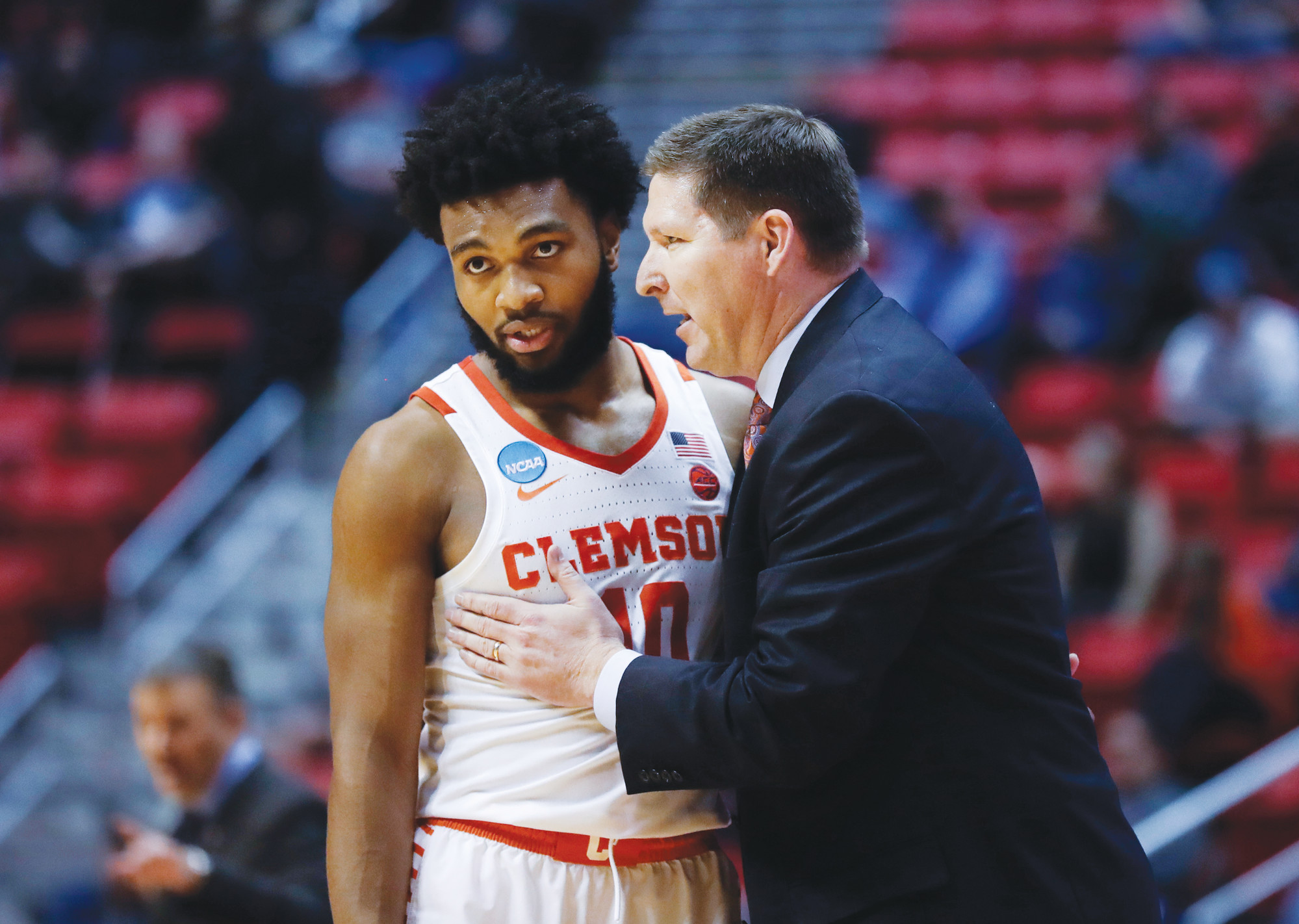 Clemson coach Brad Brownell has a word with guard Gabe DeVoe during the second half of the team's first-round victory over New Mexico State on Friday in San Diego.