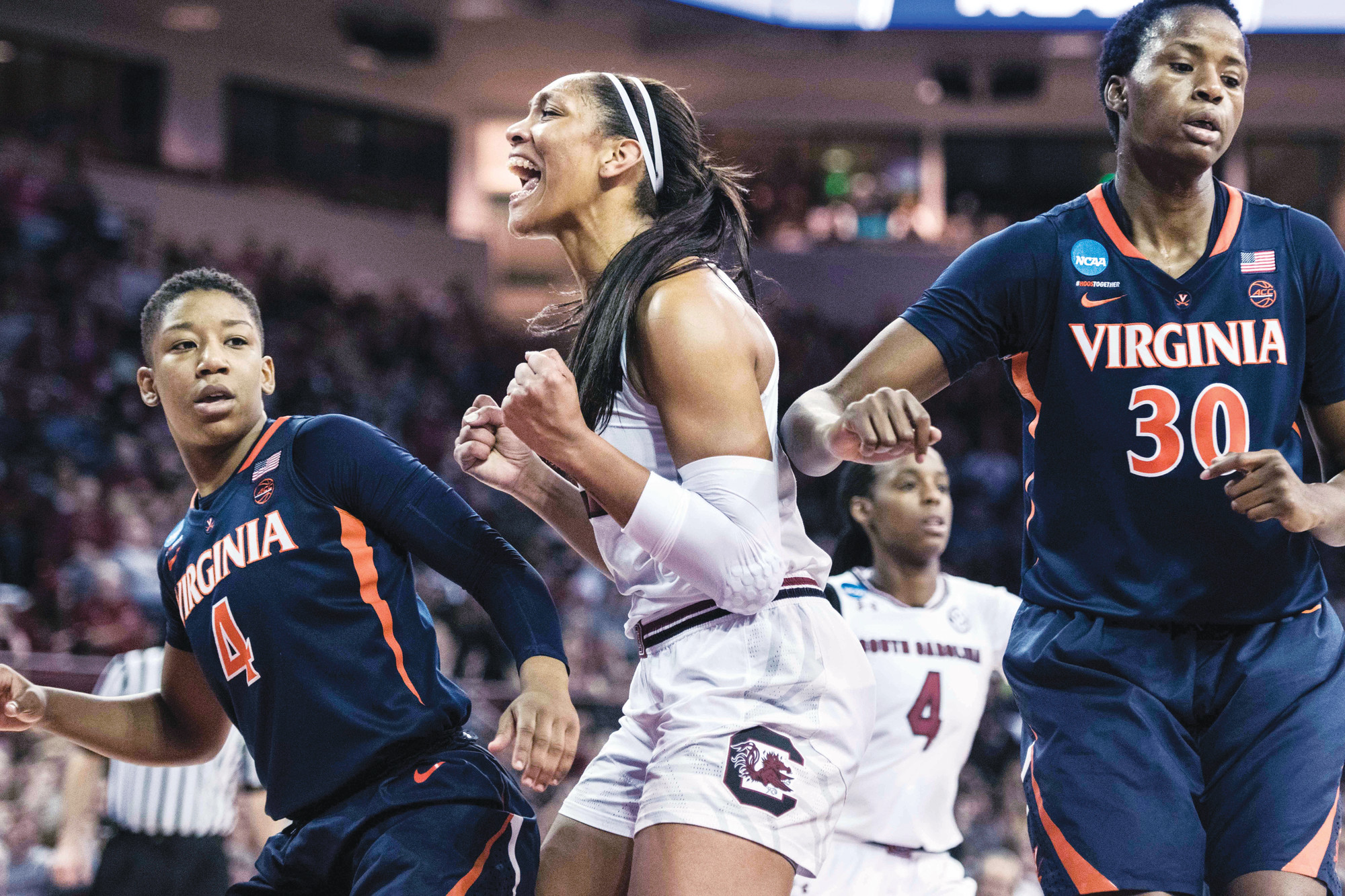 South Carolina forward A'ja Wilson, center, celebrates a basket against Virginia guard Dominique Toussaint (4) during the first half of the Gamecocks' second-round victory over the Cavaliers in the NCAA women's basketball tournament on Sunday in Columbia.