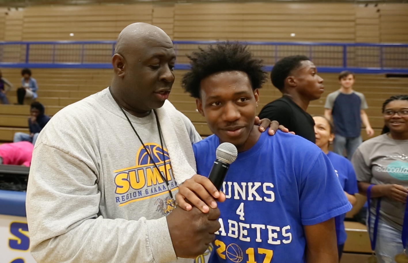 Sumter High School employee Ron McBride interviews 12th-grader Tre'zjon Bell at the Dunks for Diabetes event held Thursday at Sumter High School.