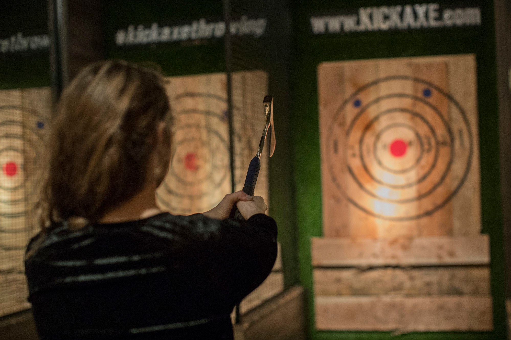 A contestant prepares to throw a hatchet at a wooden bull's-eye March 3 at the Kick Axe Throwing venue in the Brooklyn borough of New York. Ax throwing is a growing sport that some enthusiasts hope will take off the way bowling did in the last century.