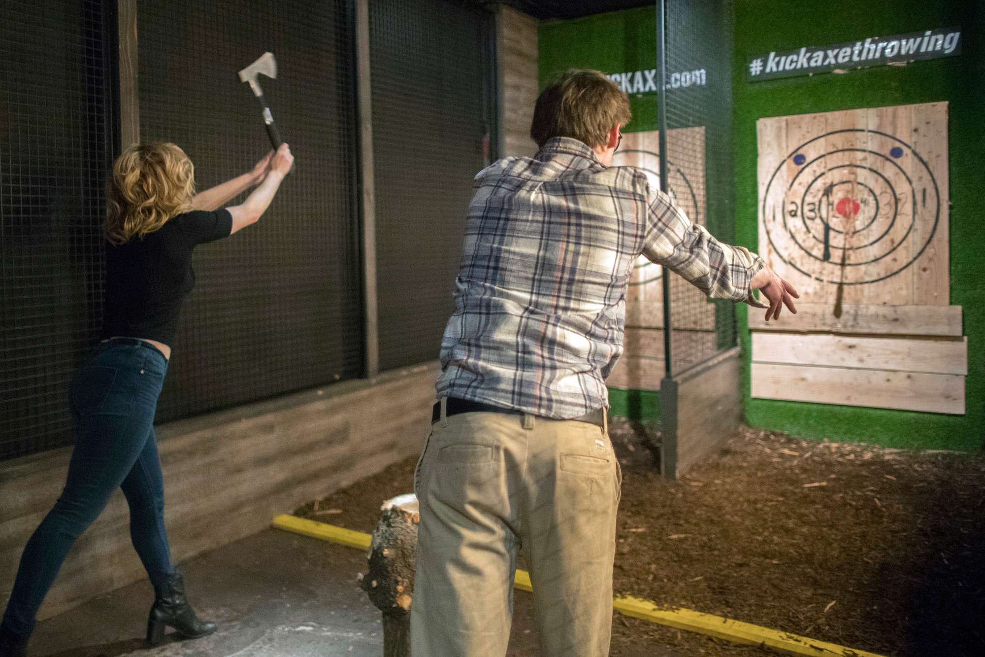 Contestants throw hatchets at wooden bull's-eyes at the Kick Axe Throwing venue in the Brooklyn borough of New York.