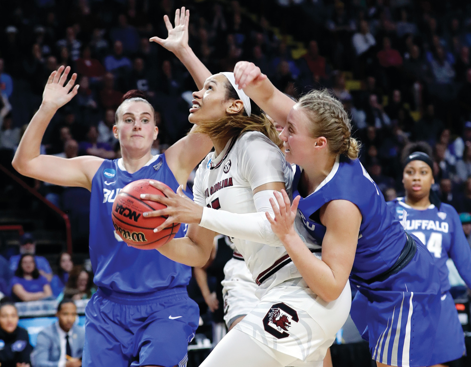 South Carolina's Alexis Jennings, center, tries to go up for a shot between Buffalo's Katherine Ups, right, and Cassie Oursler, left, during the Gamecocks' 79-63 victory on Saturday in a semifinal game in the Albany regional of the NCAA tournament in Albany, N.Y. Defending national champion USC will face top-ranked Connecticut on Monday in the regional final.