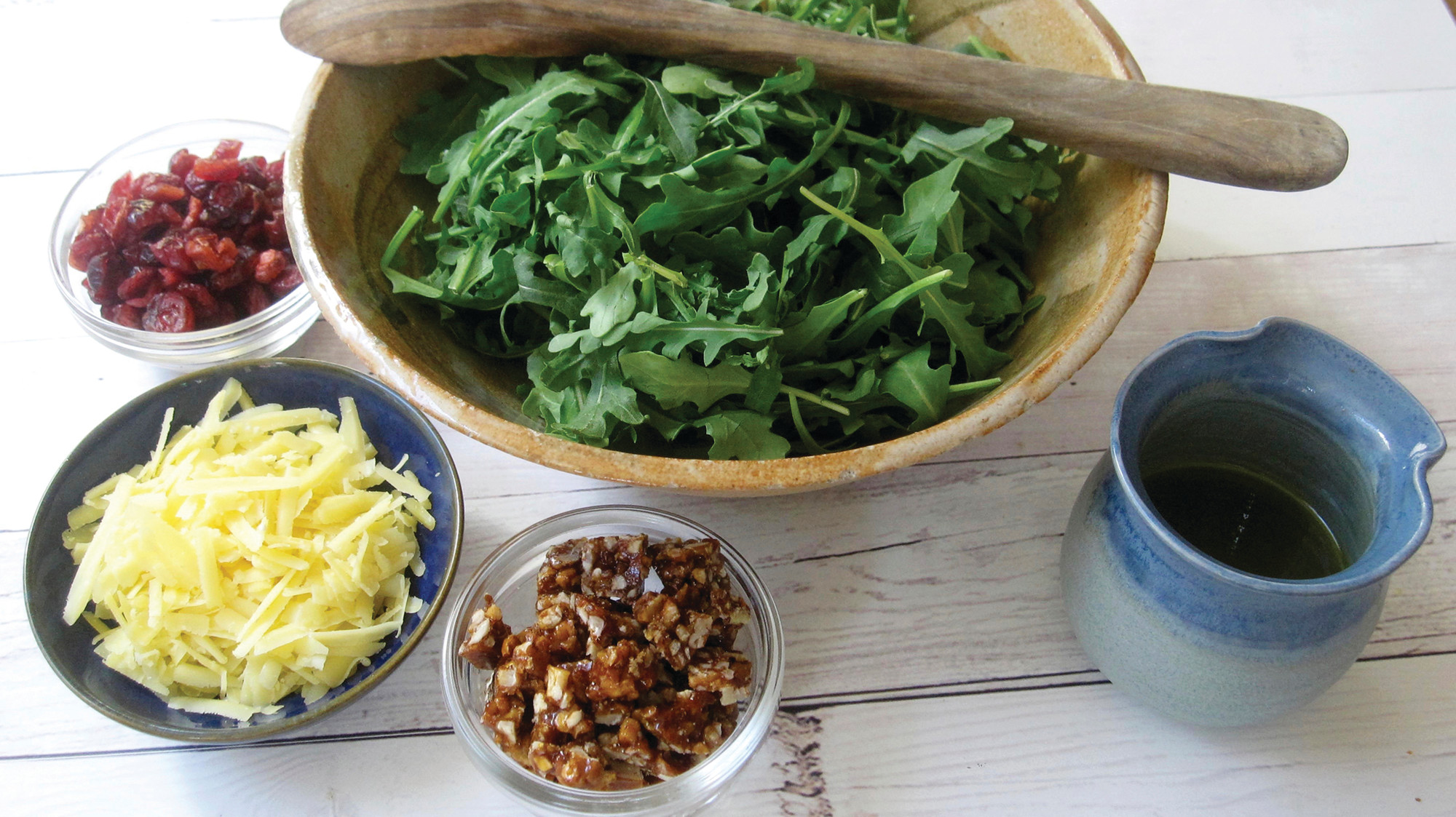 The components of this arugula salad include spicy pecan praline, dried cranberries and aged gouda. Each of the ingredients brings its own unique taste and texture to the mix, but the standout is the praline.