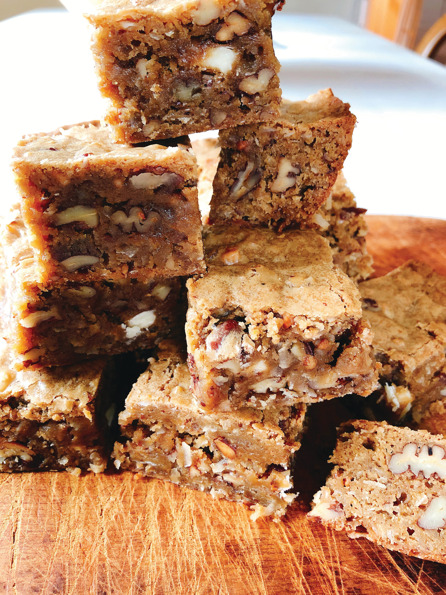 Toffee bars are packed full of pecans, toffee bits, chopped white chocolate and dried coconut, but the sprinkling of bourbon is what really takes them over the edge.