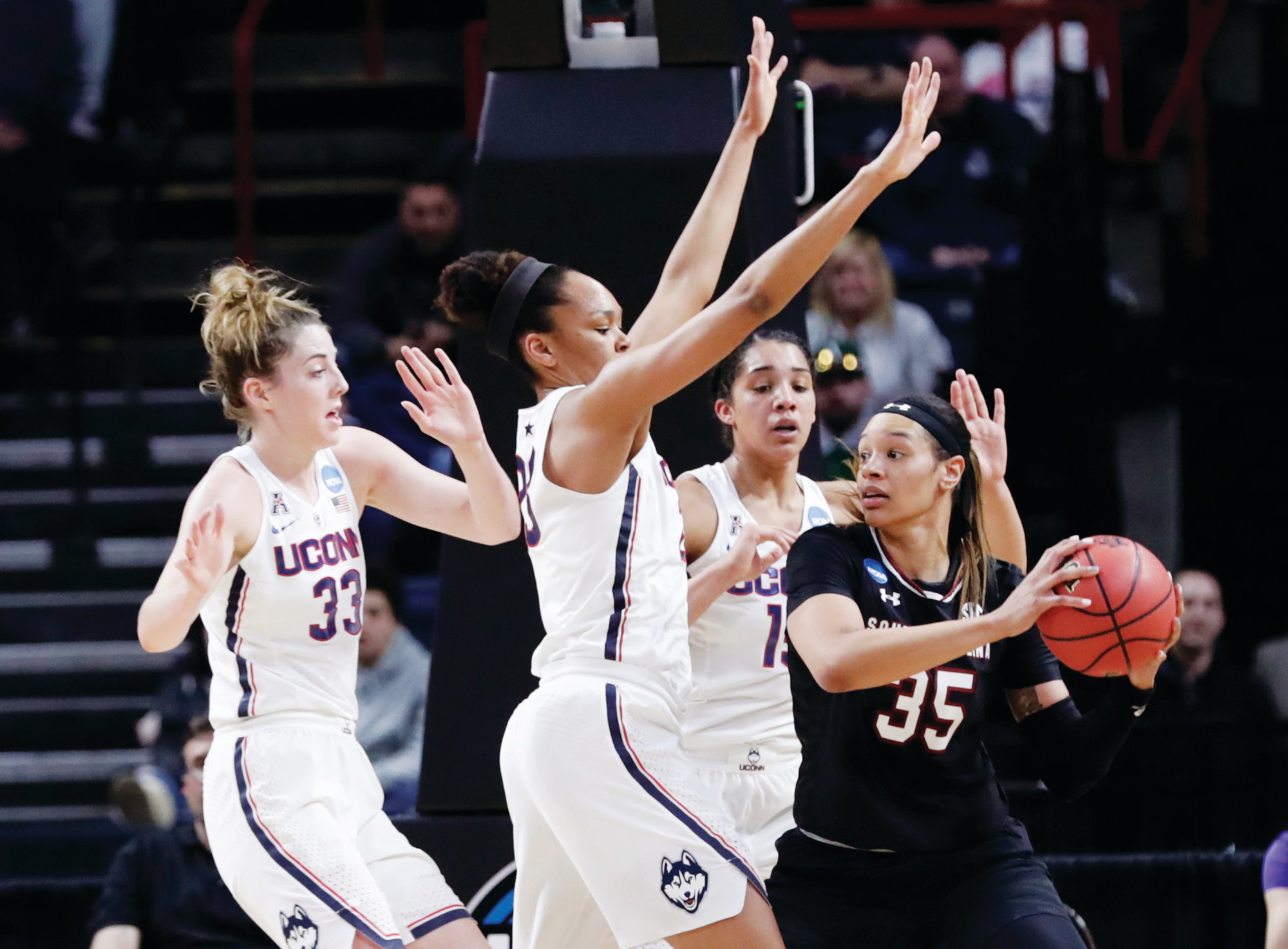 South Carolina's Alexis Jennings (35) looks to pass against a trio of Connecituct defenders during the Gamecocks' 94-65 loss in the Albany Regional championship game of the women's NCAA tournament on Monday in Albany, N.Y.