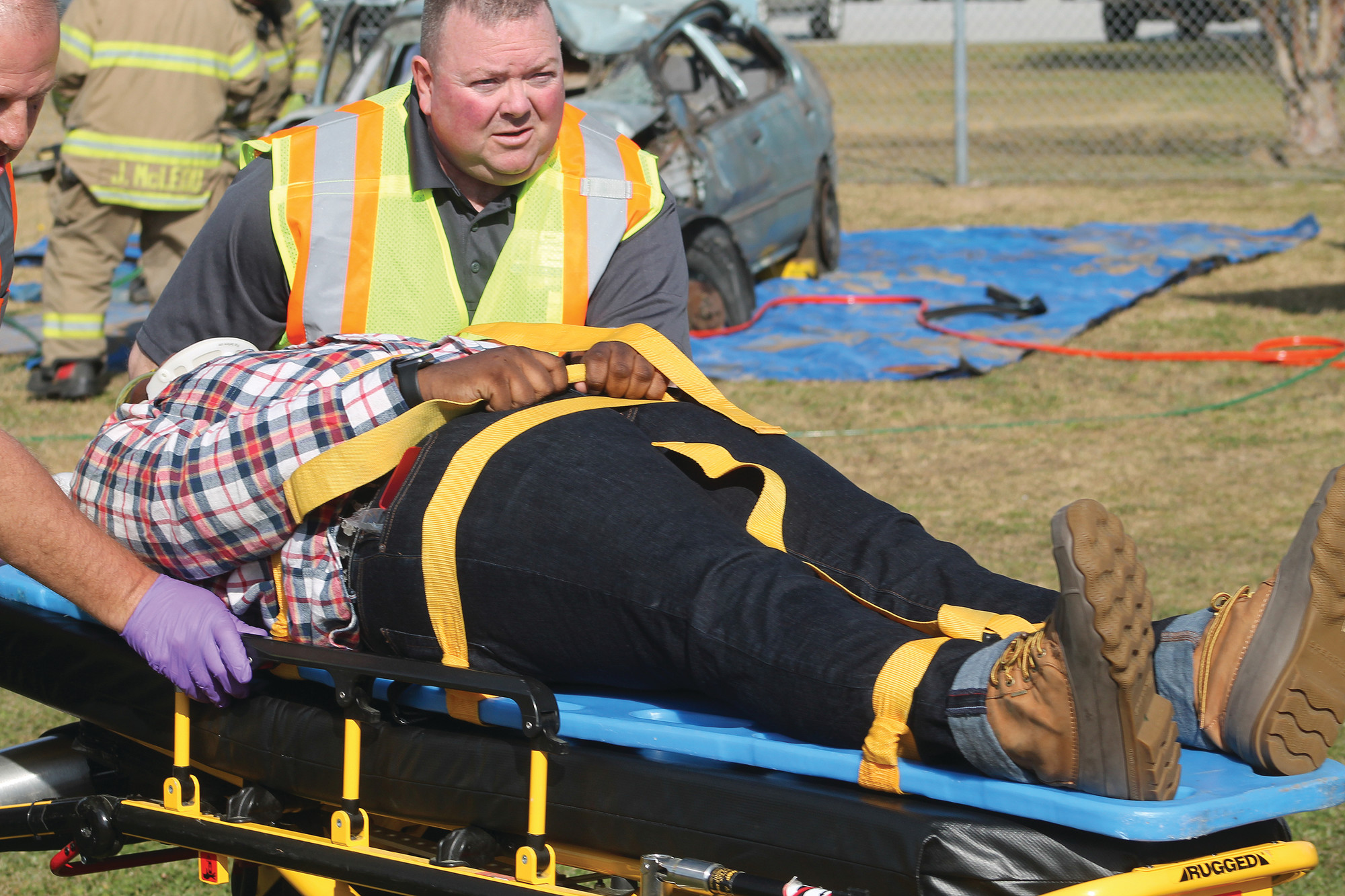 Scott's Branch High School senior Devin Brown aids local EMS personnel in a dramatization of how patients are treated at the scene of an accident and airlifted to local or trauma hospitals. See more photos from Wednesday's Prom Promise program on A5.