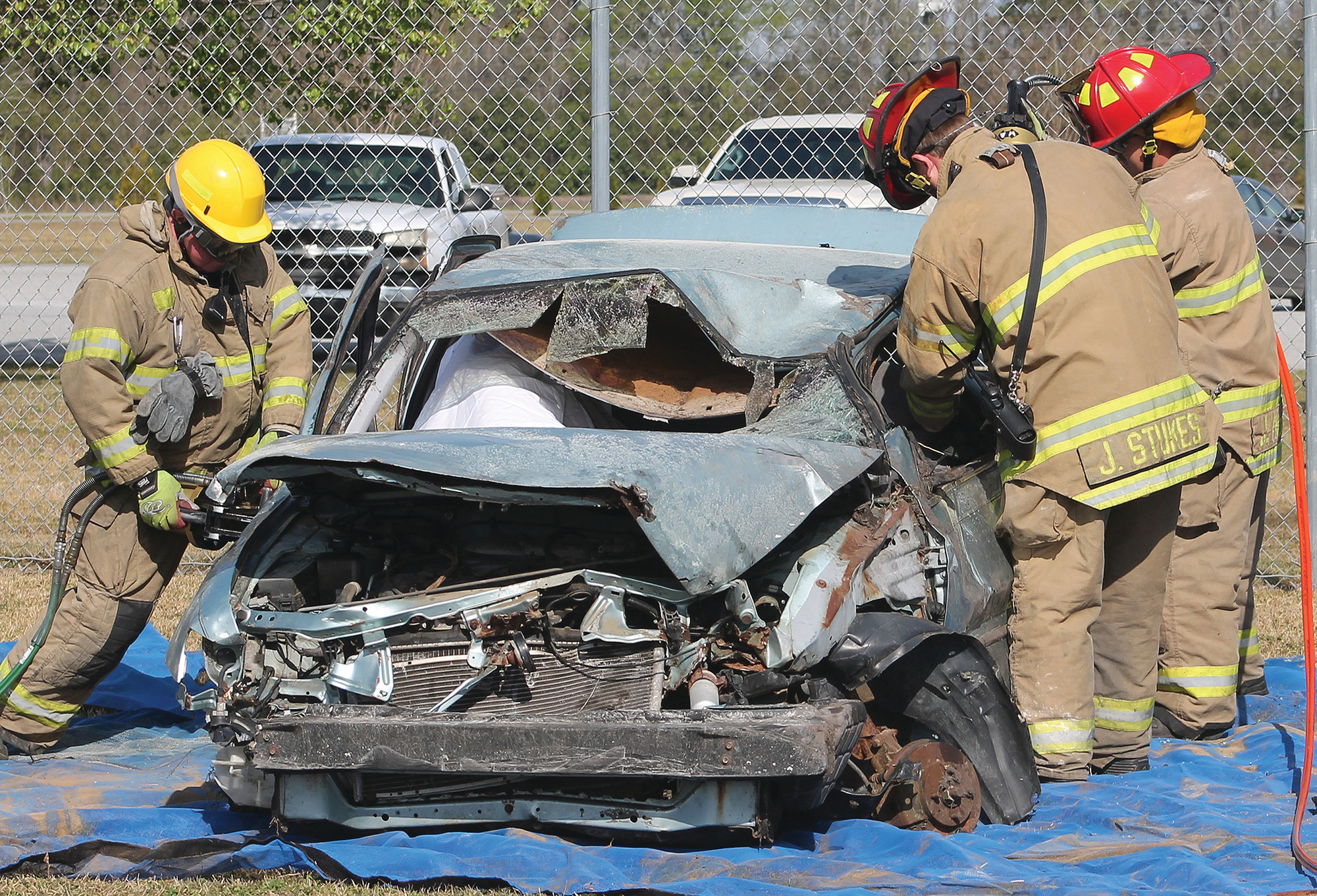 Firefighters with the Clarendon County Fire Department demonstrate how difficult it is to extricate individuals trapped in a vehicle.