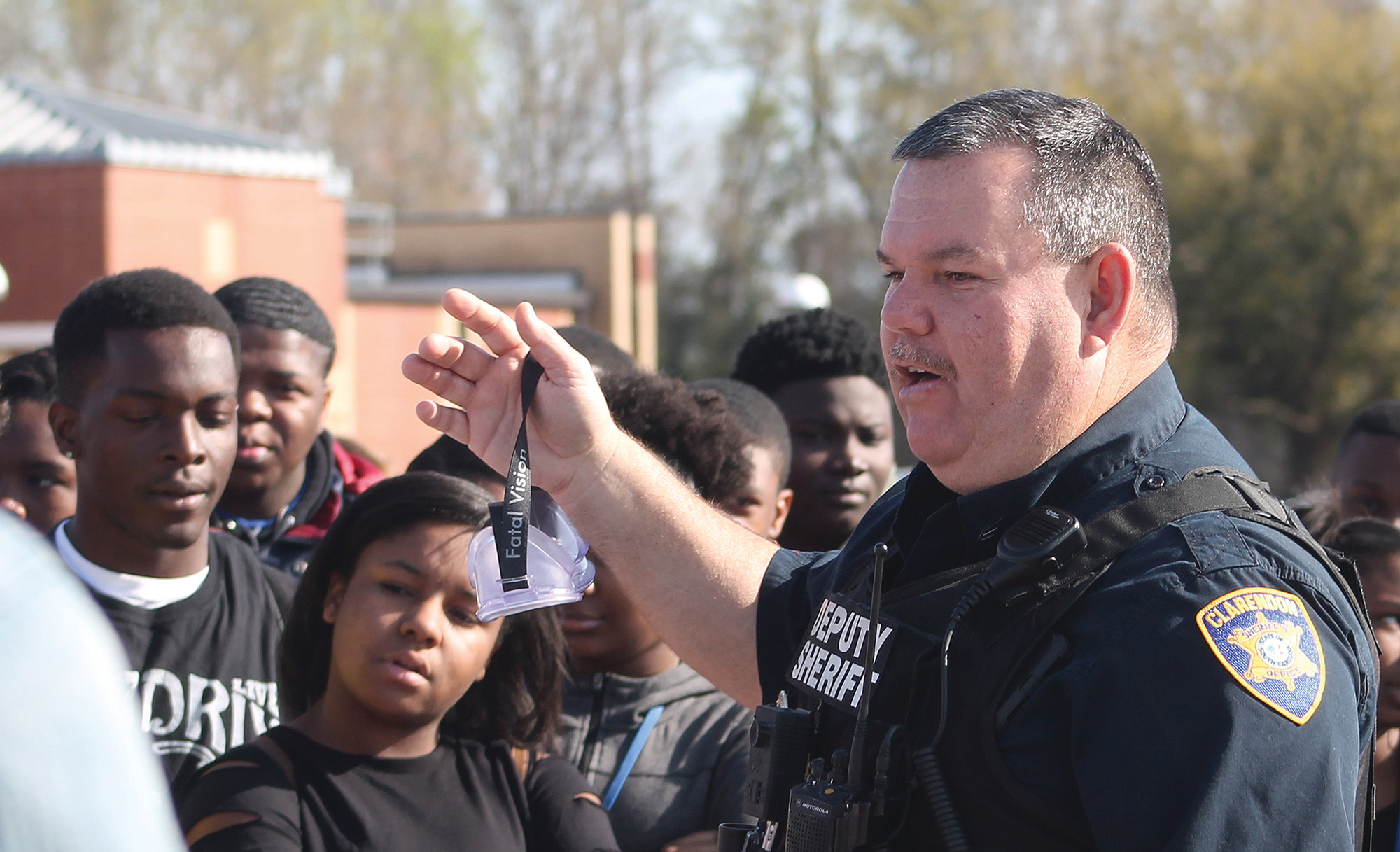 Sgt. David Floyd, head of the Traffic Division at the Clarendon County Sheriff's Office, talks to students at Scott's Branch High School on Wednesday about the importance of not driving while impaired by drinking and/or drugs.