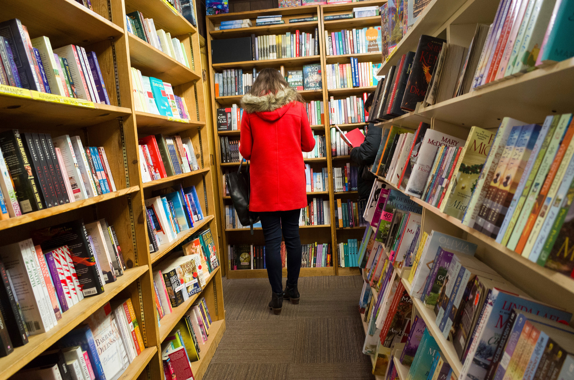 Shoppers browse among the narrow rows of books Feb. 17 at The Book Loft of German Village in Columbus, Ohio. The 40-year-old bookstore features 32 rooms of books.