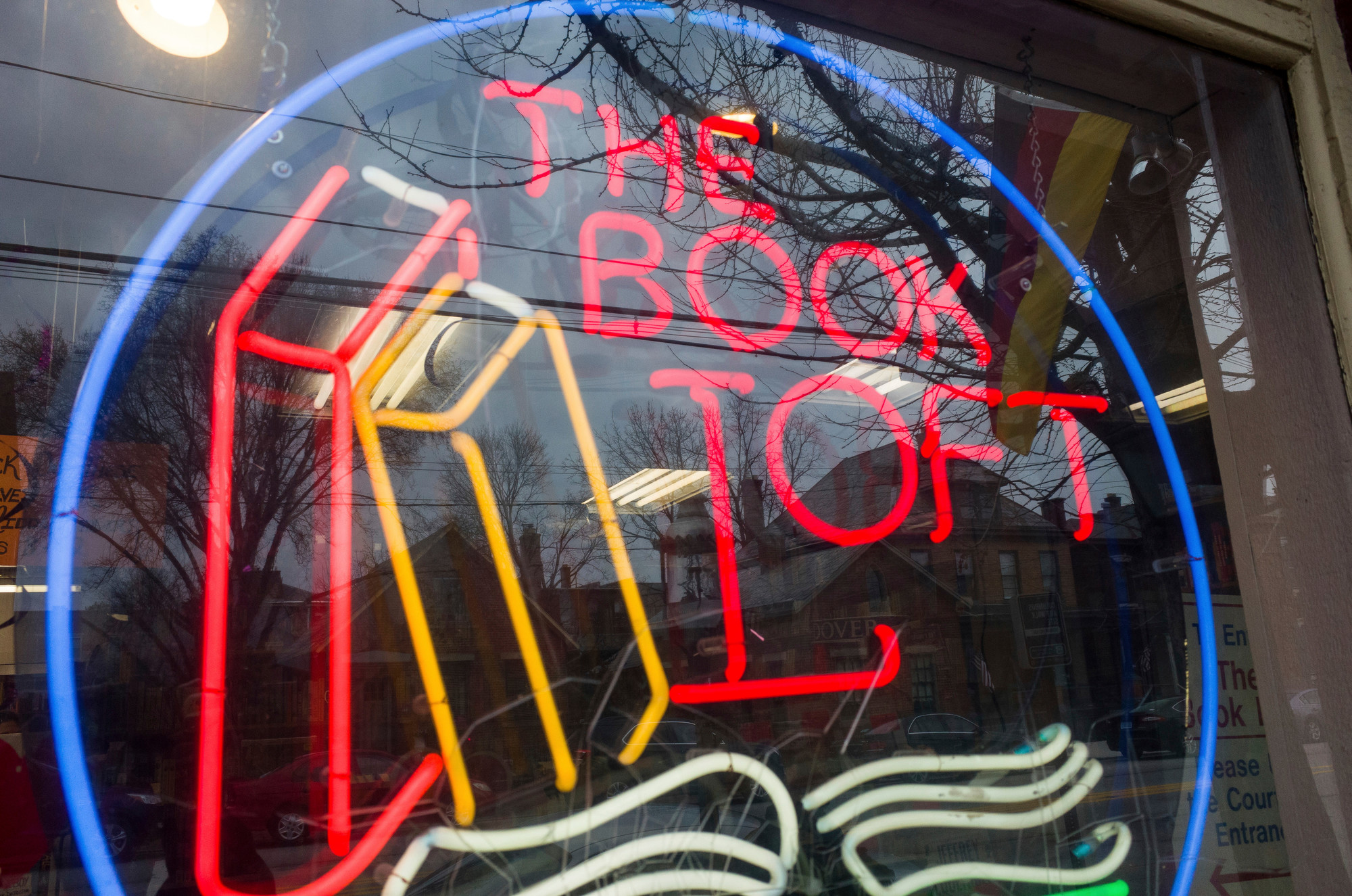 Neighborhood buildings are reflected in the front window of The Book Loft of German Village in Columbus, Ohio, on Feb. 17. The 40-year-old bookstore features 32 rooms of books.