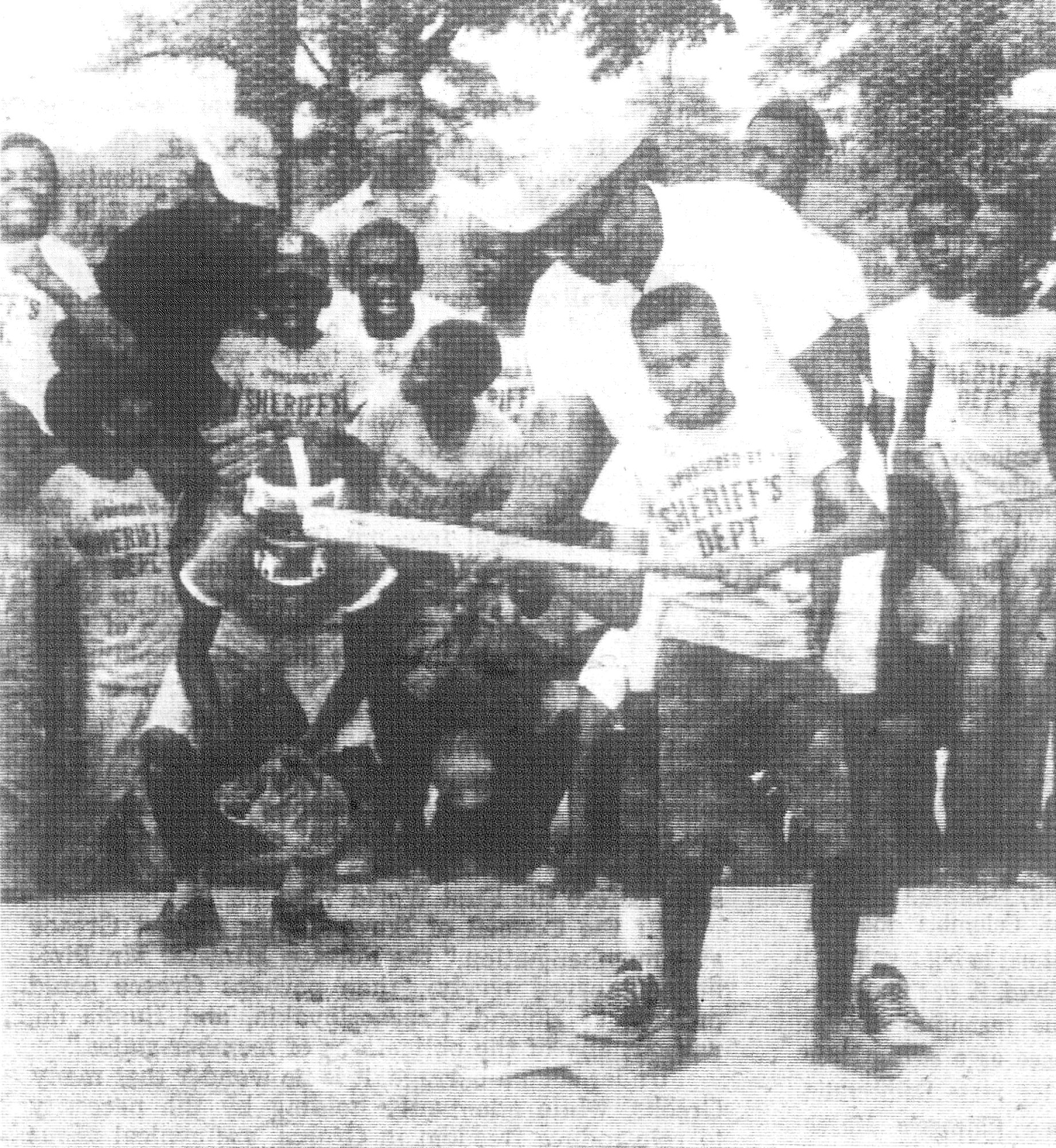 1968 - Coach Robert A. Jenkins instructs Robert Brown on the proper way to bat as other youngsters look on. This was part of the Youth Softball Program at Stonehill sponsored by the sheriff's department.