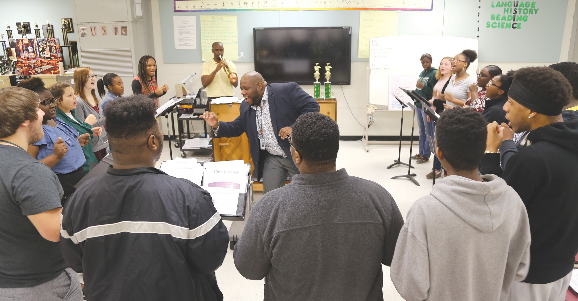 Under the direction of choral director Herbert Johnson, center, the Lakewood High School Vocal Jazz Ensemble practices last week at the school.