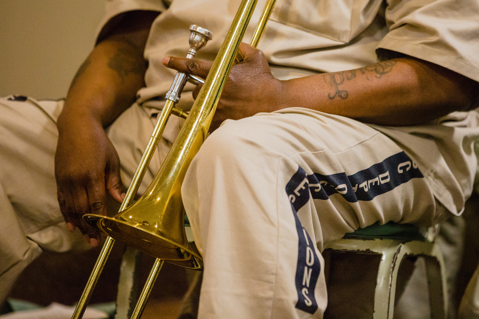 A Lee Correctional Institution inmate holds his trombone in between songs.