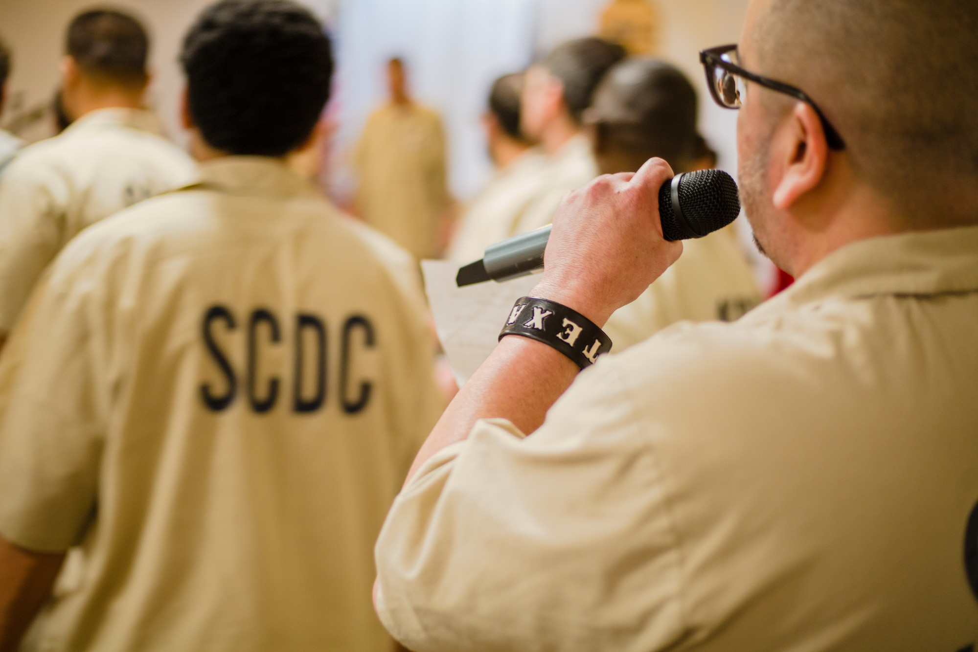 A Lee Correctional Institution inmate sings with others.