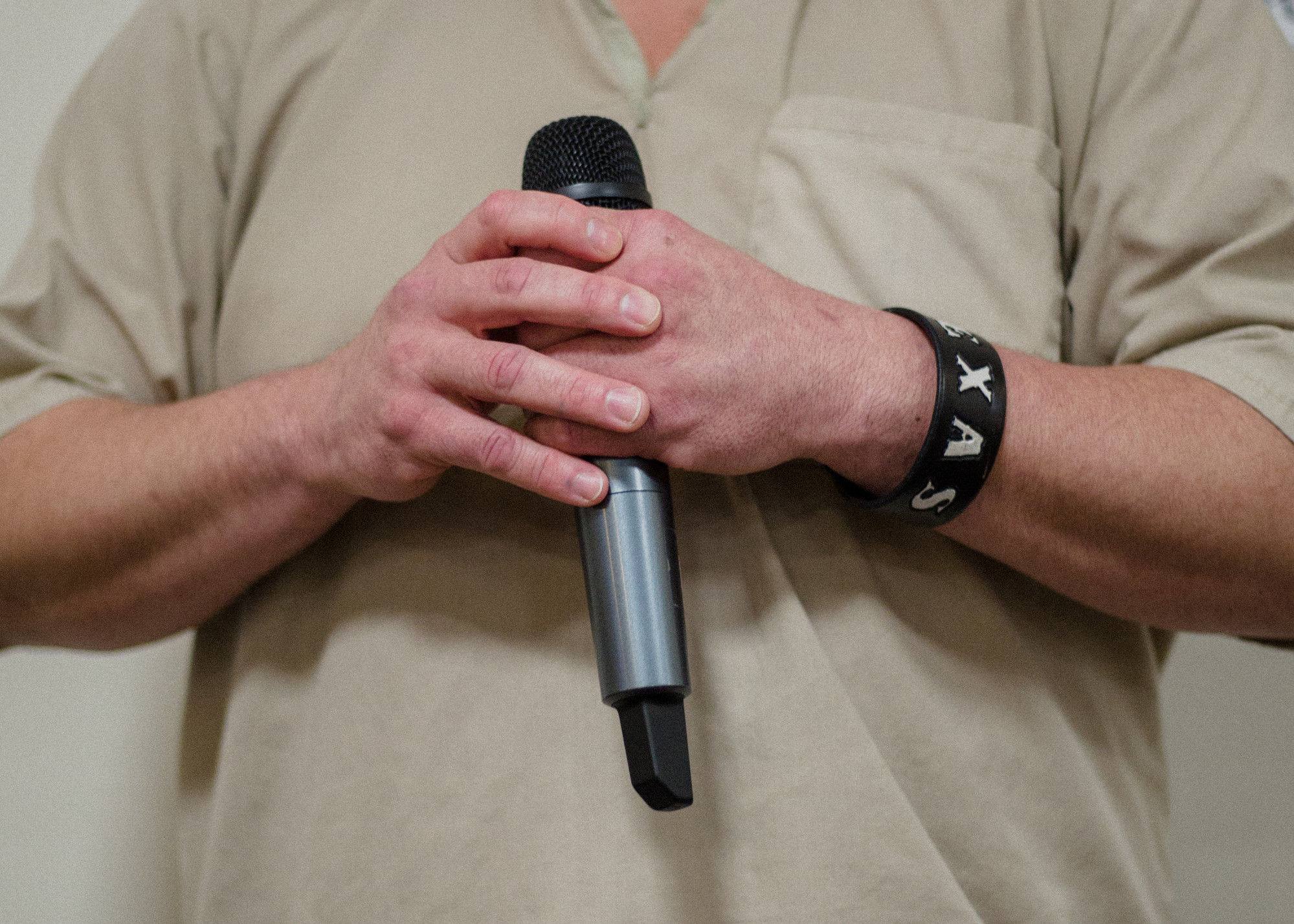 A Lee Correctional Institution inmate holds his microphone, waiting for his turn.