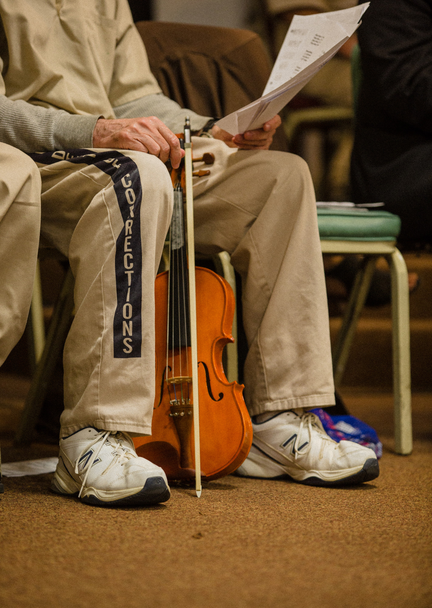 A Lee Correctional Institution inmate sits with his violin.