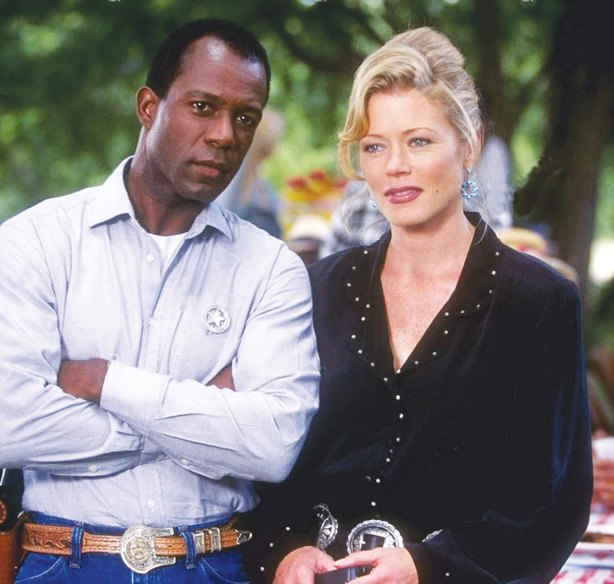 "CBS PUBLICITY PHOTOClarence Gilyard Jr. as James Trivette and Sheree J. Wilson as Alex Cahill in ""Walker, Texas Ranger."""