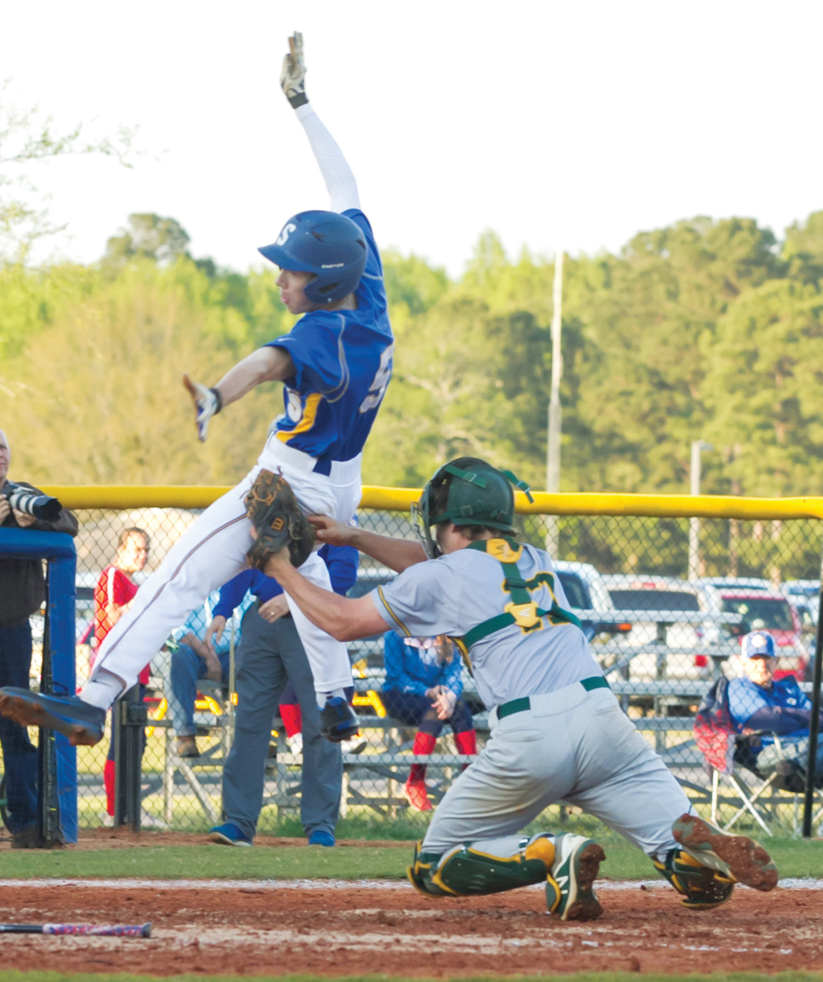 Sumter's Jackson Hoshour (5) is tagged out at home by West Florence catcher Brennan Herndon in the Gamecocks' 3-2, 8-inning win on Tuesday at Gamecock Field.