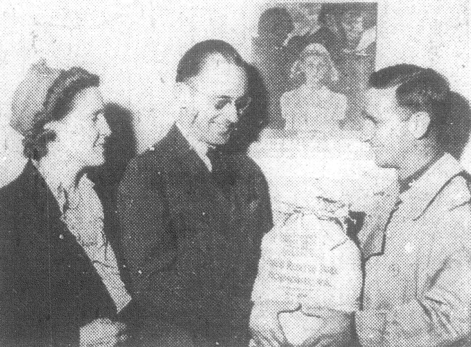 1943 - Lt. E.C. Walsh Jr., personal affair officer at Shaw Field, presents a money bag totaling $4,855.25 donated by soldiers and civilians at the air base to J. Clark Hughes, director of the Sumter Community and War Chest Fund, while Mrs. Bessie Boykin, executive secretary of the fund, looks on.