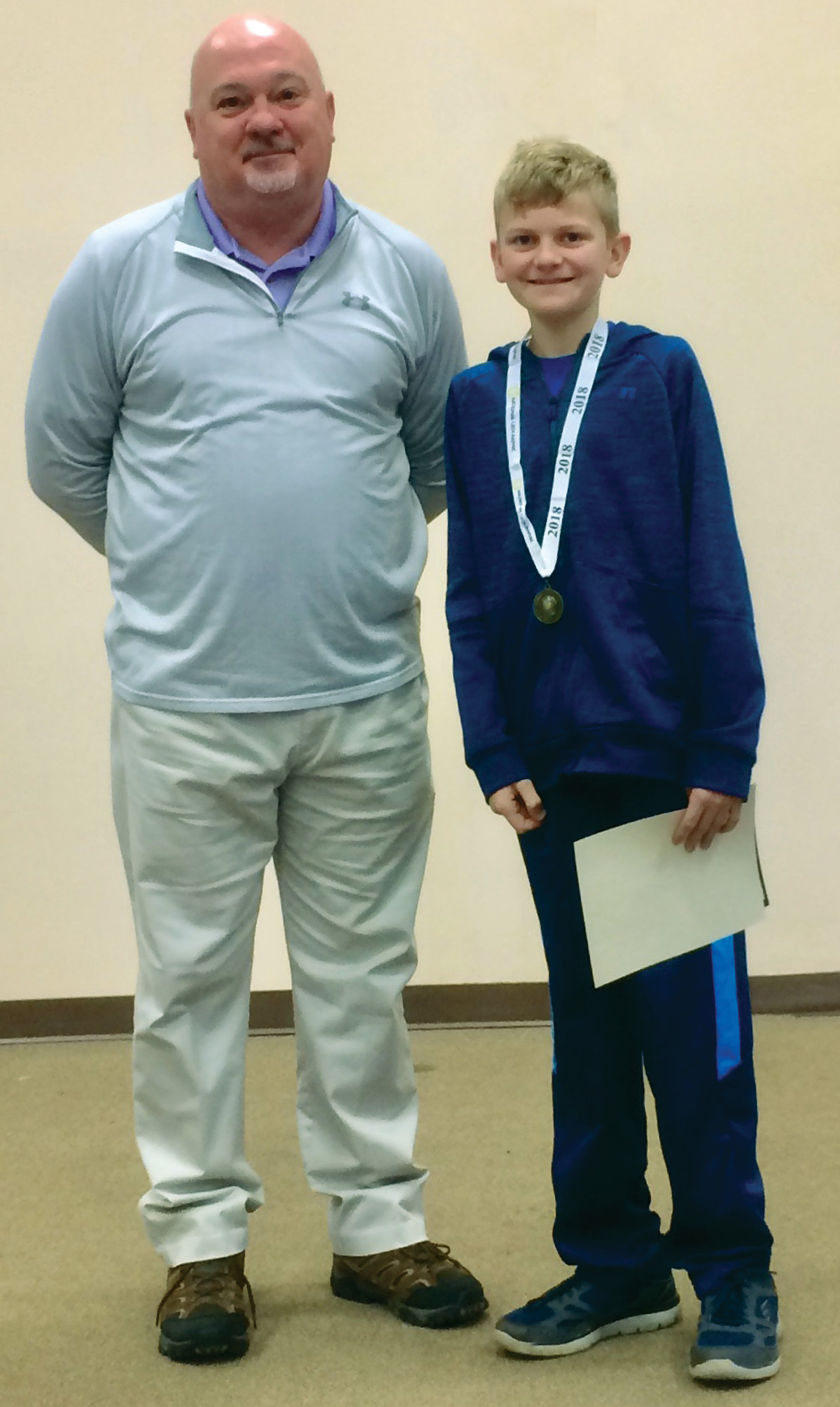 PHOTO PROVIDEDA. Reisenauer won the National Geographic Bee at St. Anne & St. Jude Catholic School. In April, he will compete for the state title against students from across South Carolina. Dan Spivey, left, is Reisenauer's social studies and geography teacher.