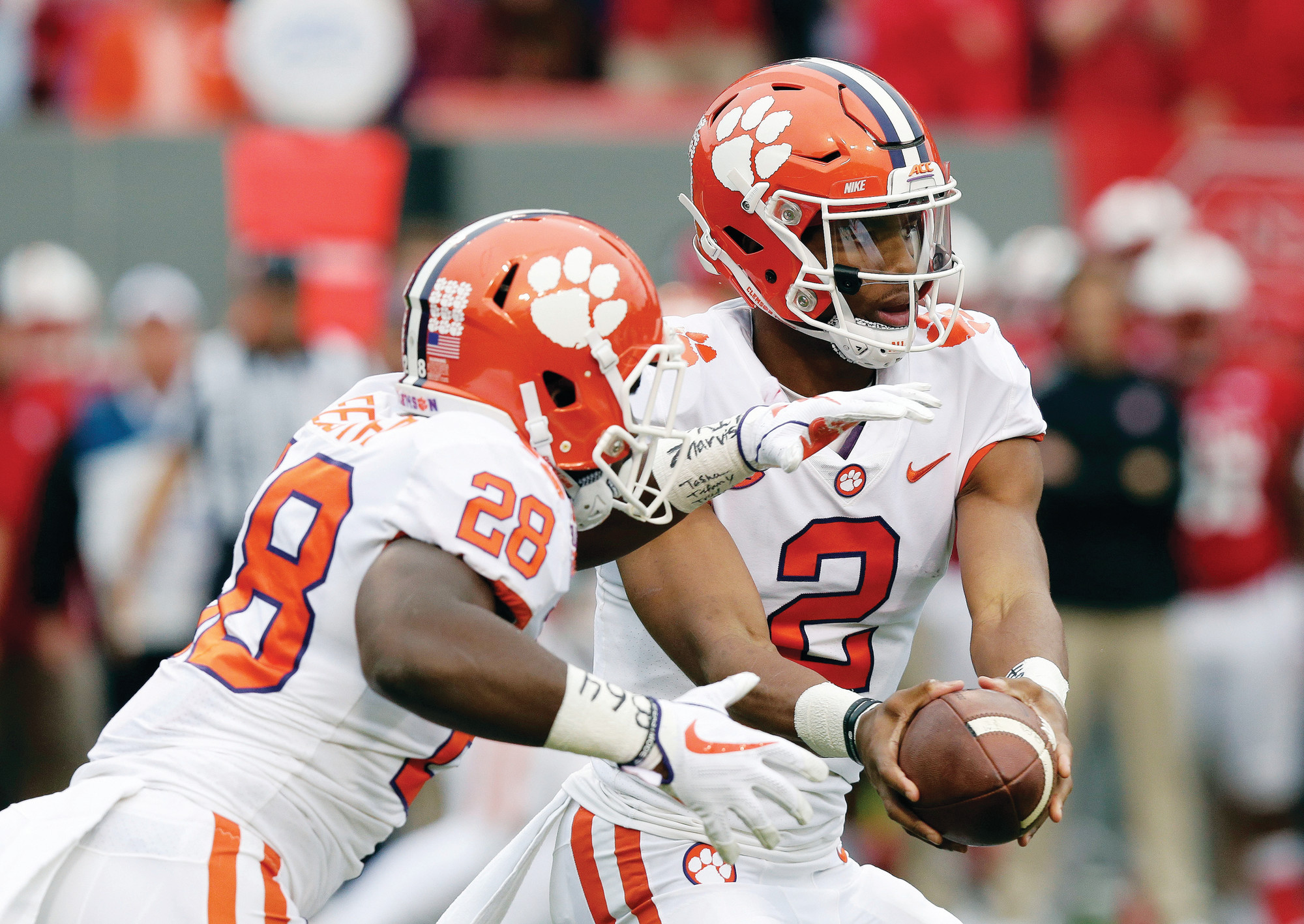 Clemson quarterback Kelly Bryant (2) hands off to Tavien Feaster (28) during the first half of their 2017 game against North Carolina State in Raleigh, N.C.