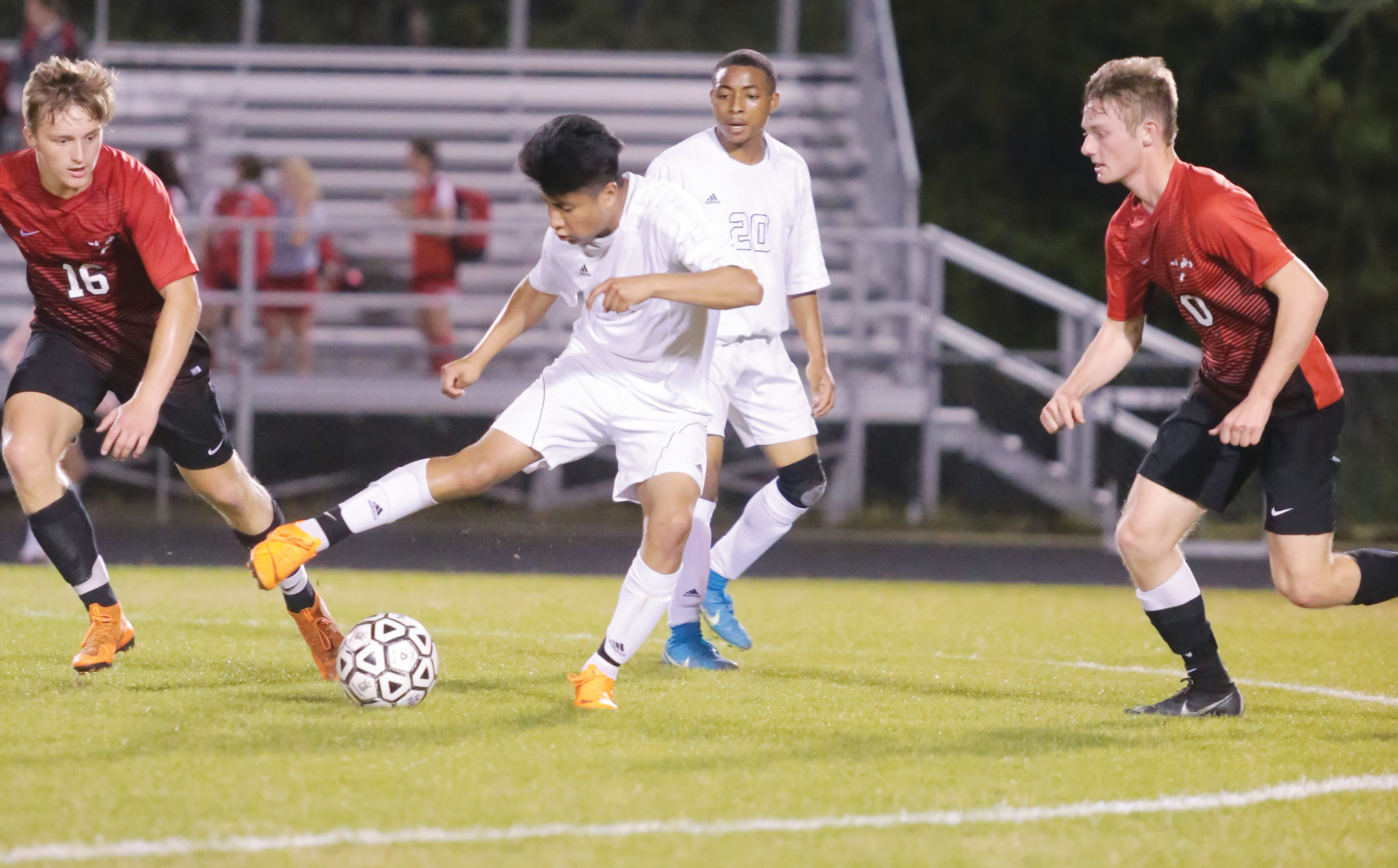 Crestwood's Luis Gutierez-Mendoza works the ball in traffic as teammate Deontay Singleton looks on and a pair of Hartsville defenders pursue during the Knights' 2-0 loss to the Foxes on Friday at the Crestwood field.