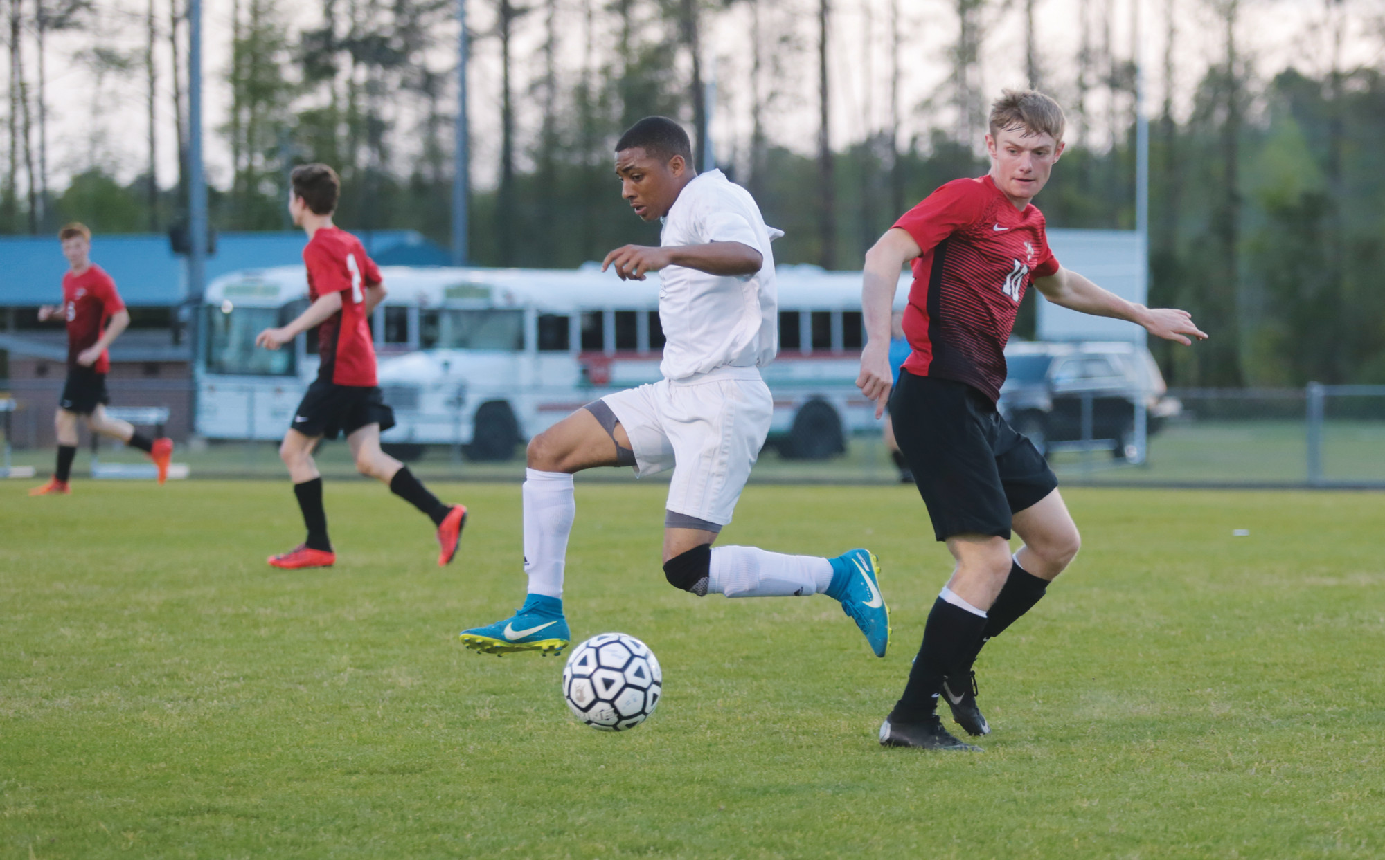 Crestwood's Deontay Singleton gets away from a Hartsville defender during the Knights' 2-0 loss to the region-leading Foxes on Friday at the Crestwood field.