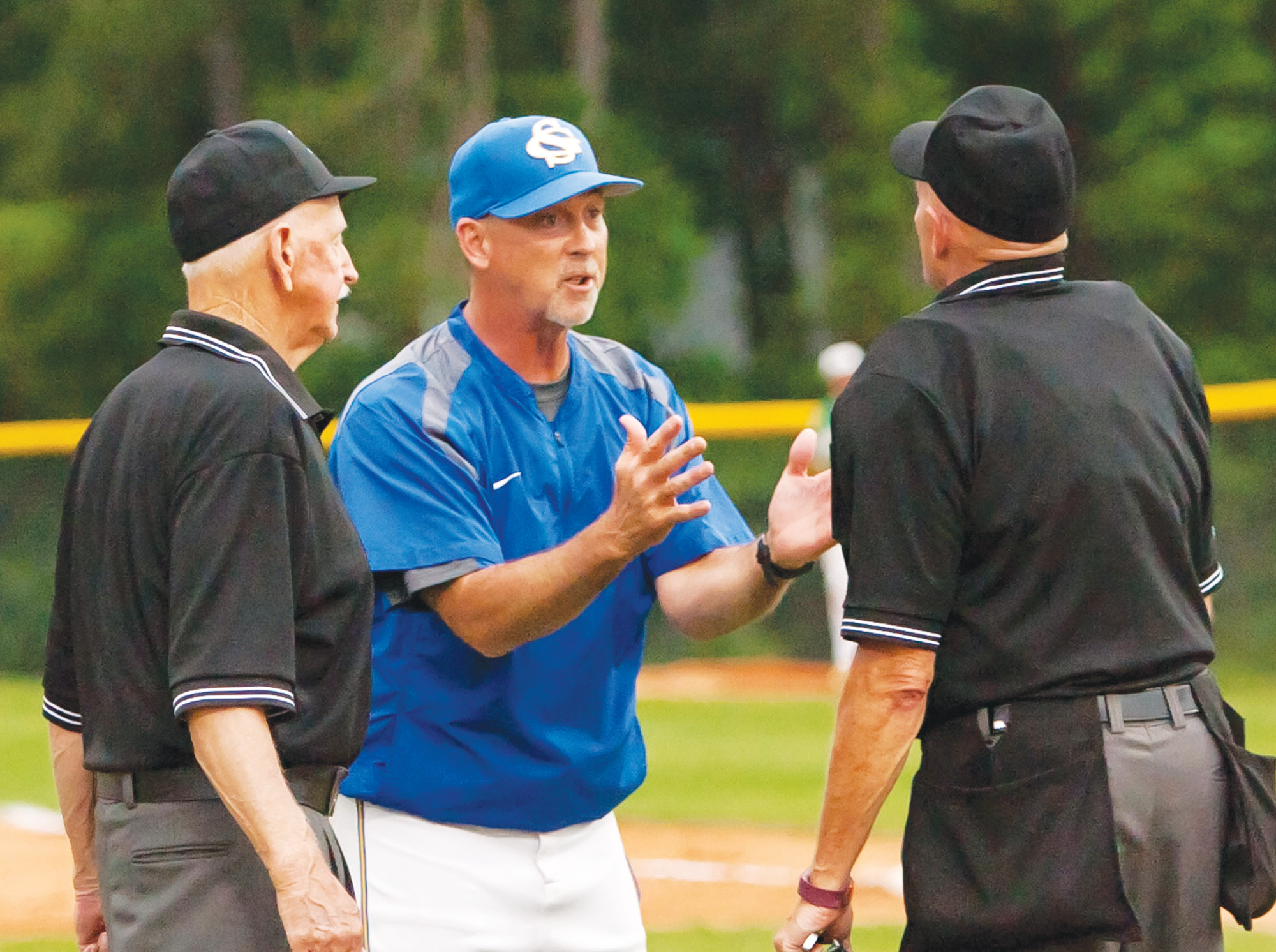 Sumter High School baseball head coach Brooks Shumake, center, picked up his 400th career victory on Friday as the Gamecocks beat Conway 3-2 in eight innings at Gamecock Field.