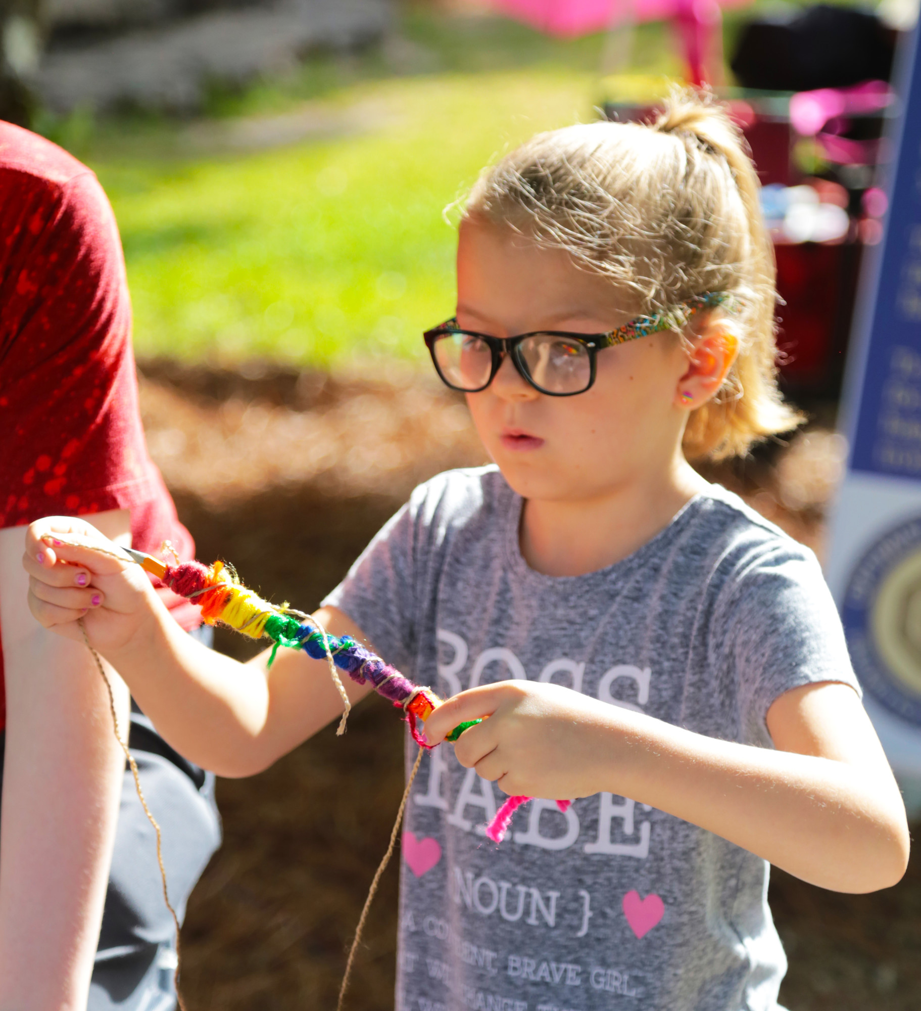 Children decorated pencils attached to sticks to incorporate art and nature during the Earth Day event.