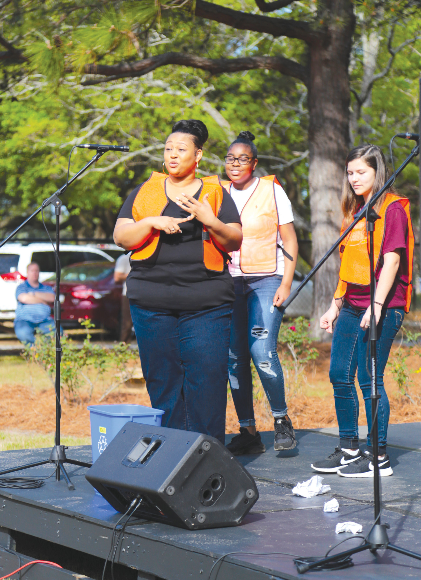 Melissa Pollard and students from her seventh-grade class at Ebenezer Middle School perform a rap that she wrote encouraging people to recycle.