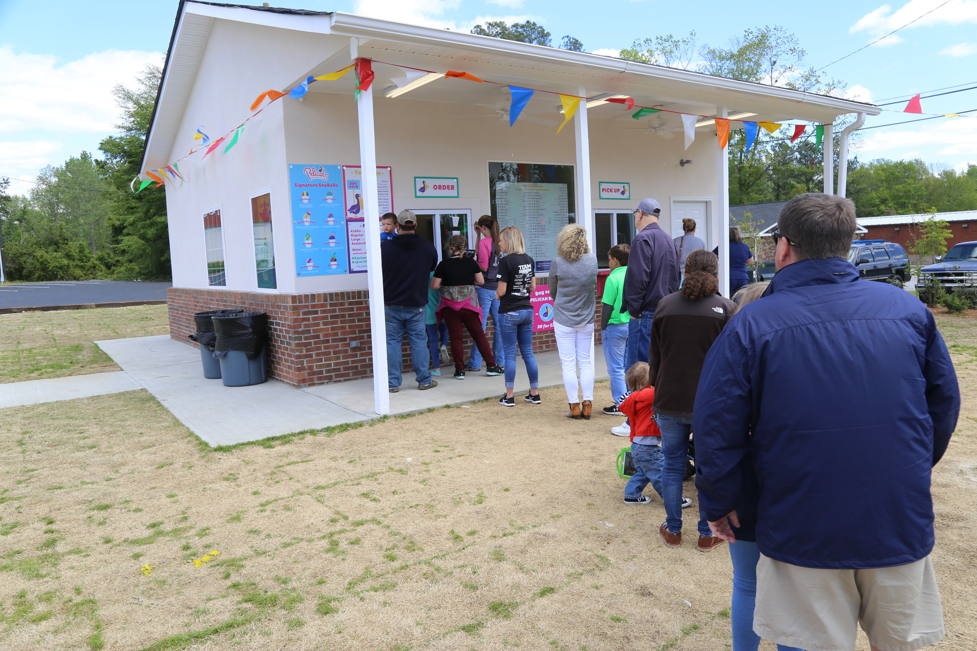 Despite temperatures in the high 50s Monday, a line of people wait to order at Pelican's SnoBalls, 471 N. Guignard Drive. The shaved ice snowball shop opened April 5. Hours are Monday-Saturday, noon to 9 p.m., and Sunday, 1 to 9 p.m. For more information, visit www.pelicanssnoballs.com.