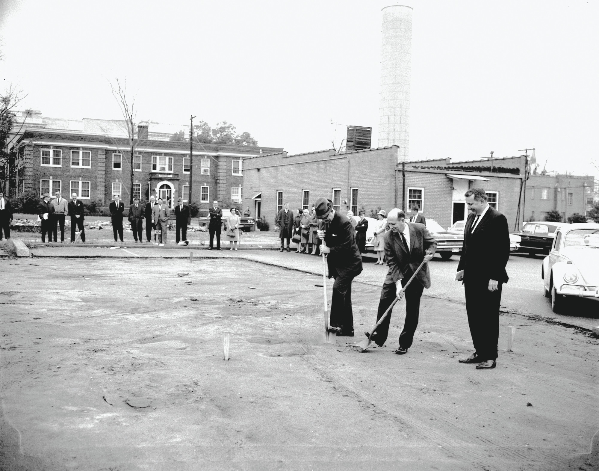 Sumterites break ground for the library in 1967 with the Agricultural building in the background.