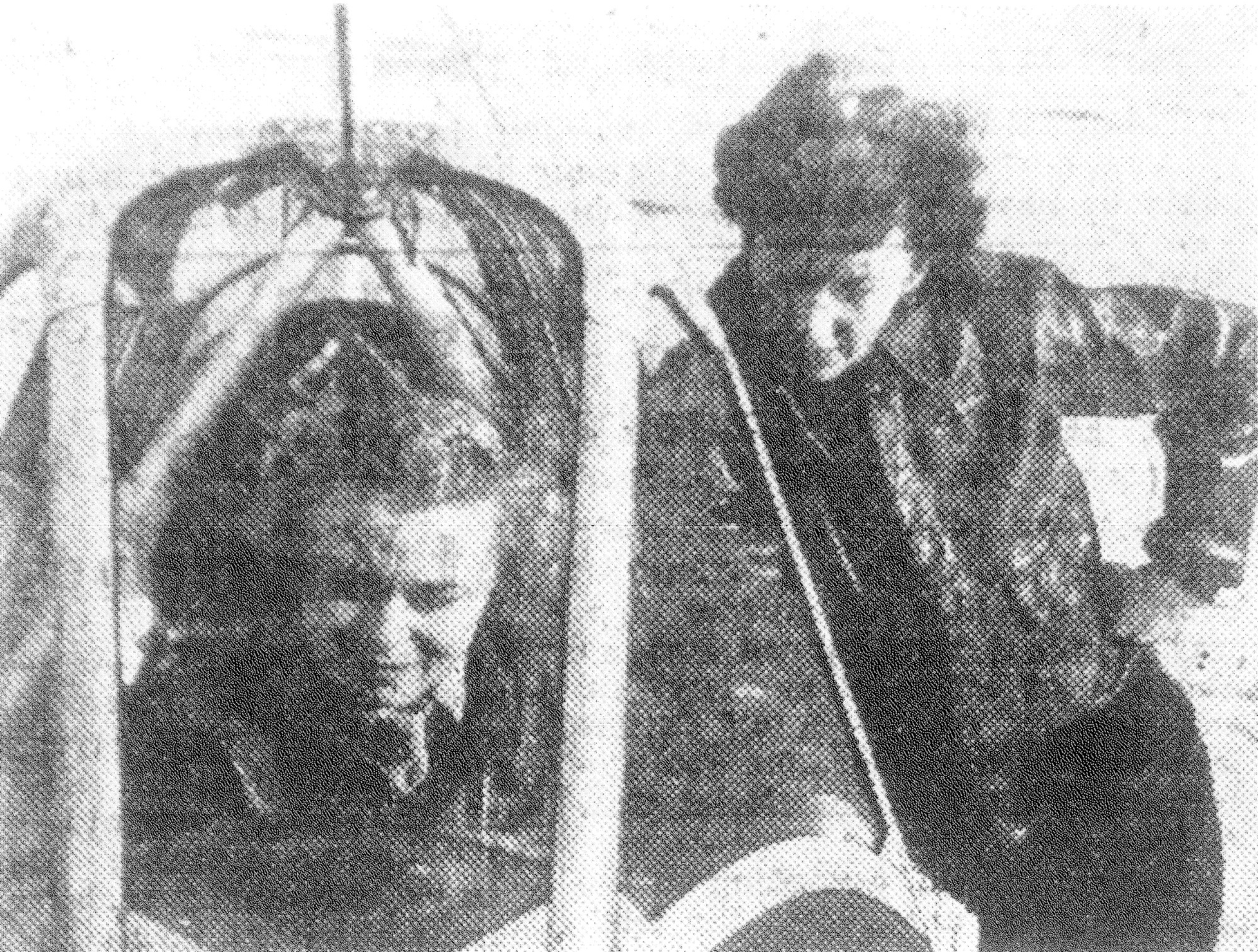 "Ethel Meyer, of Lake City, Minnesota, seated in the cockpit of a basic training plane, and Marjorie Poppell, of Miami, Florida, standing on the wing, take time out for a ""wing talk"" session in 1943. They were Women Army Service Pilots and were the first to be assigned for duty at Shaw Field."