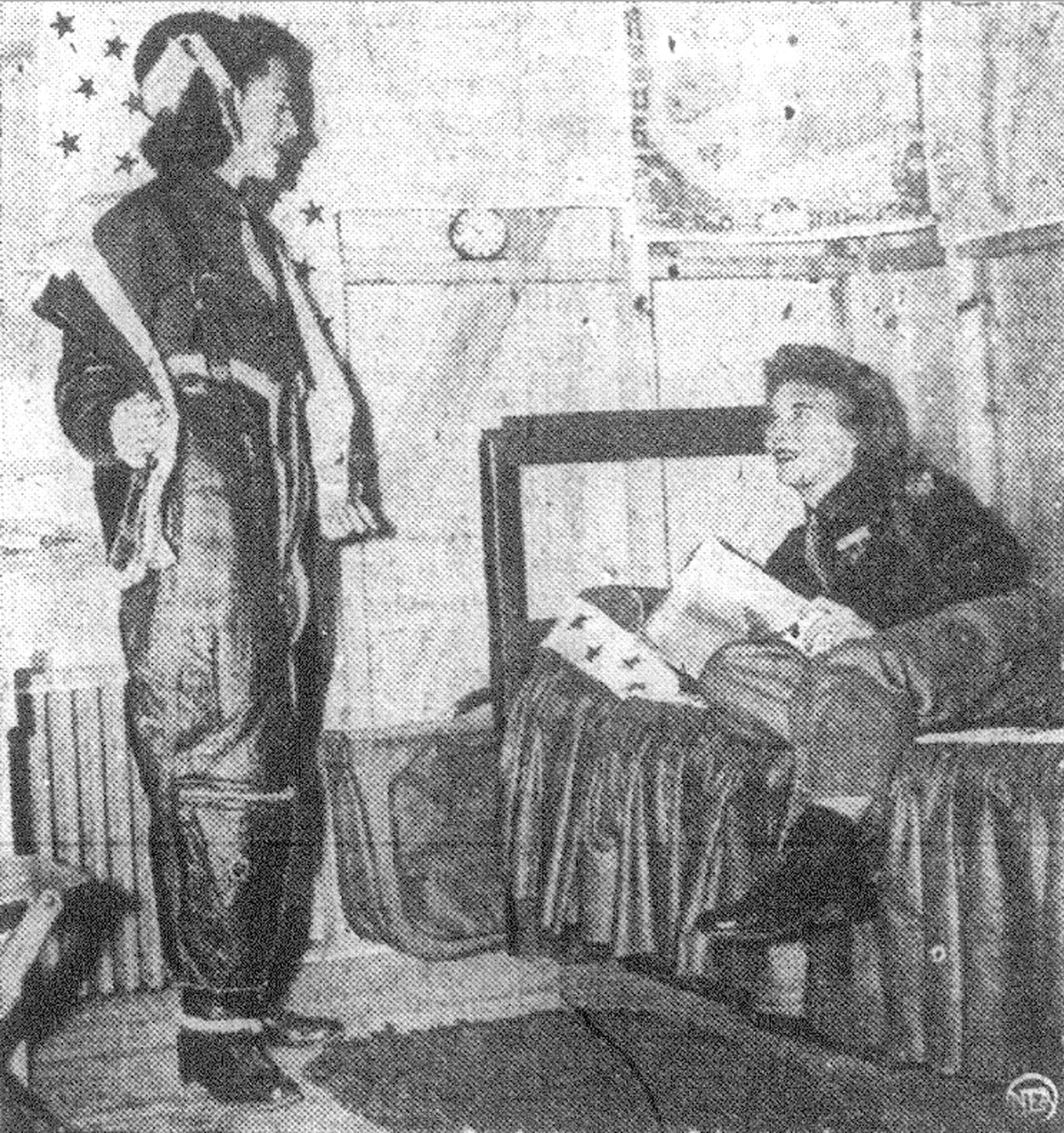 WASP Helen W. Snapp, of Washington, D.C., comes in from a flight and describes it to WASP Margaret Bruns of Milwaukee, Wisconsin, in their barracks room in 1943.