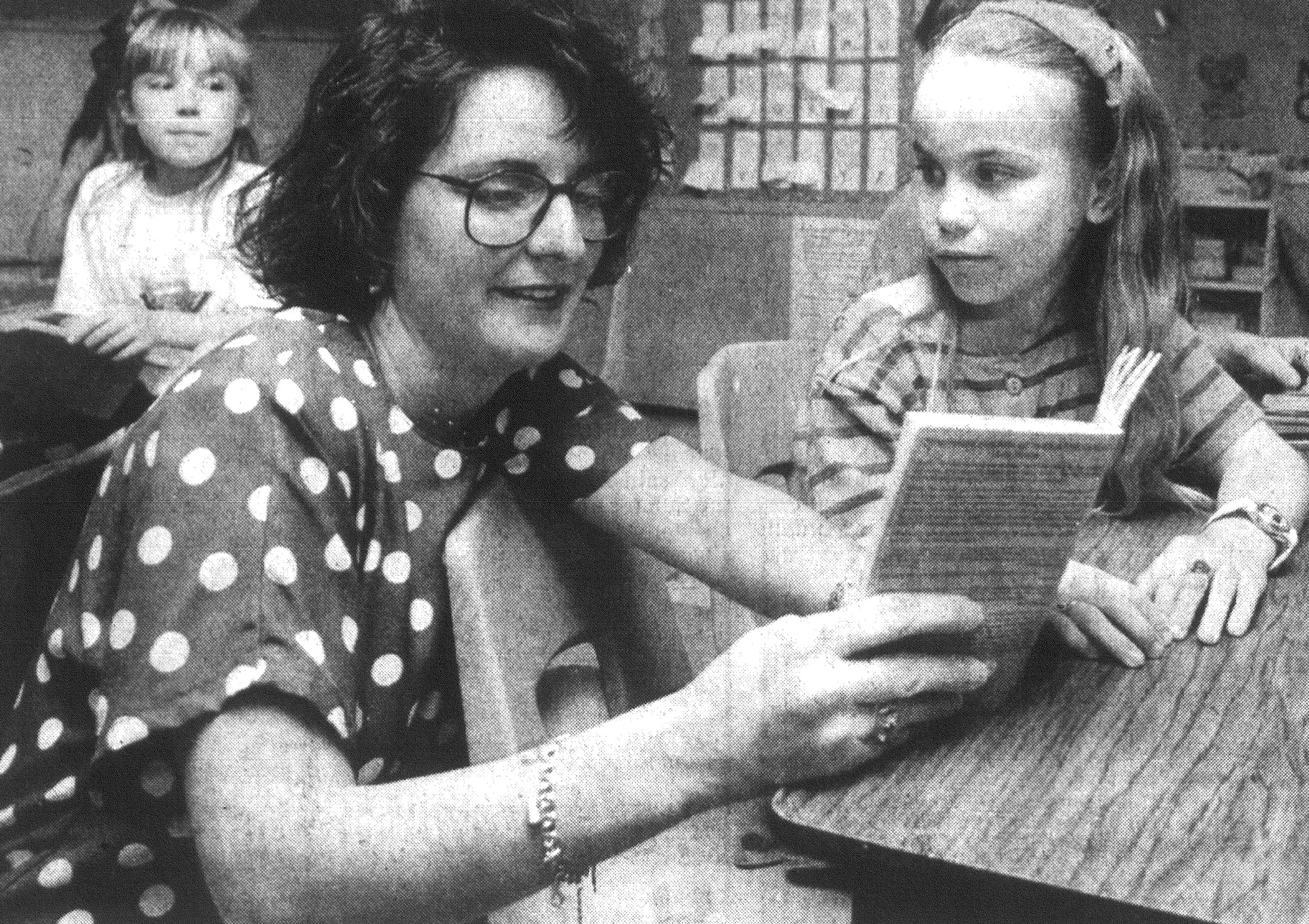 1993 - Suzann Sears helps Millwood Elementary School student Jessica Courtoy with a classroom assignment.