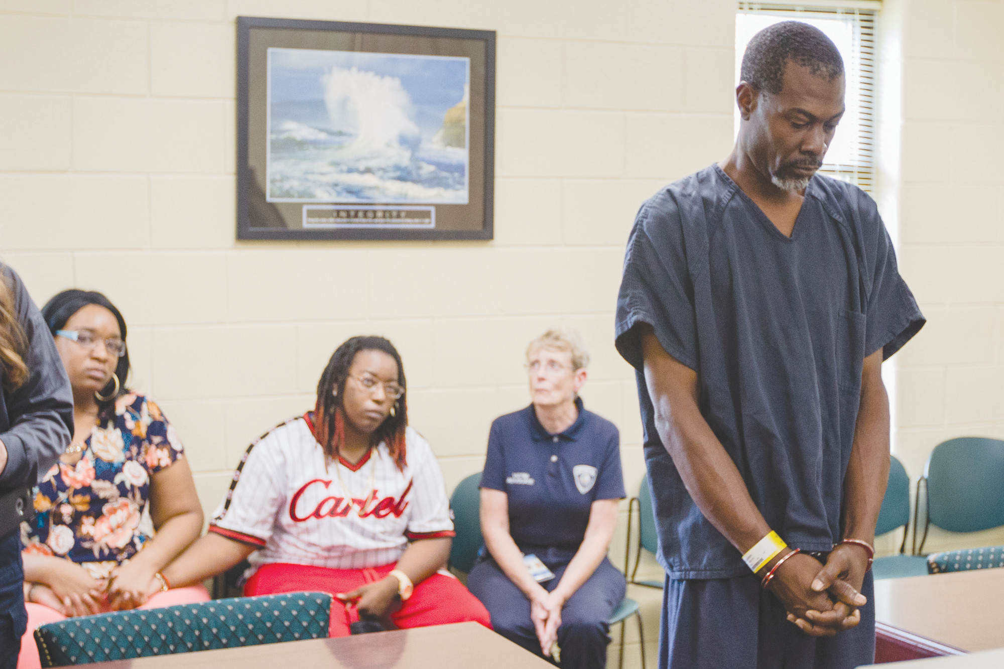 Alonzo Shaw, 50, stands before the family of Lois Smith, 36, during a first appearance hearing at Sumter-Lee Regional Detention Center on Friday. Shaw is charged with murder in Smith's death.