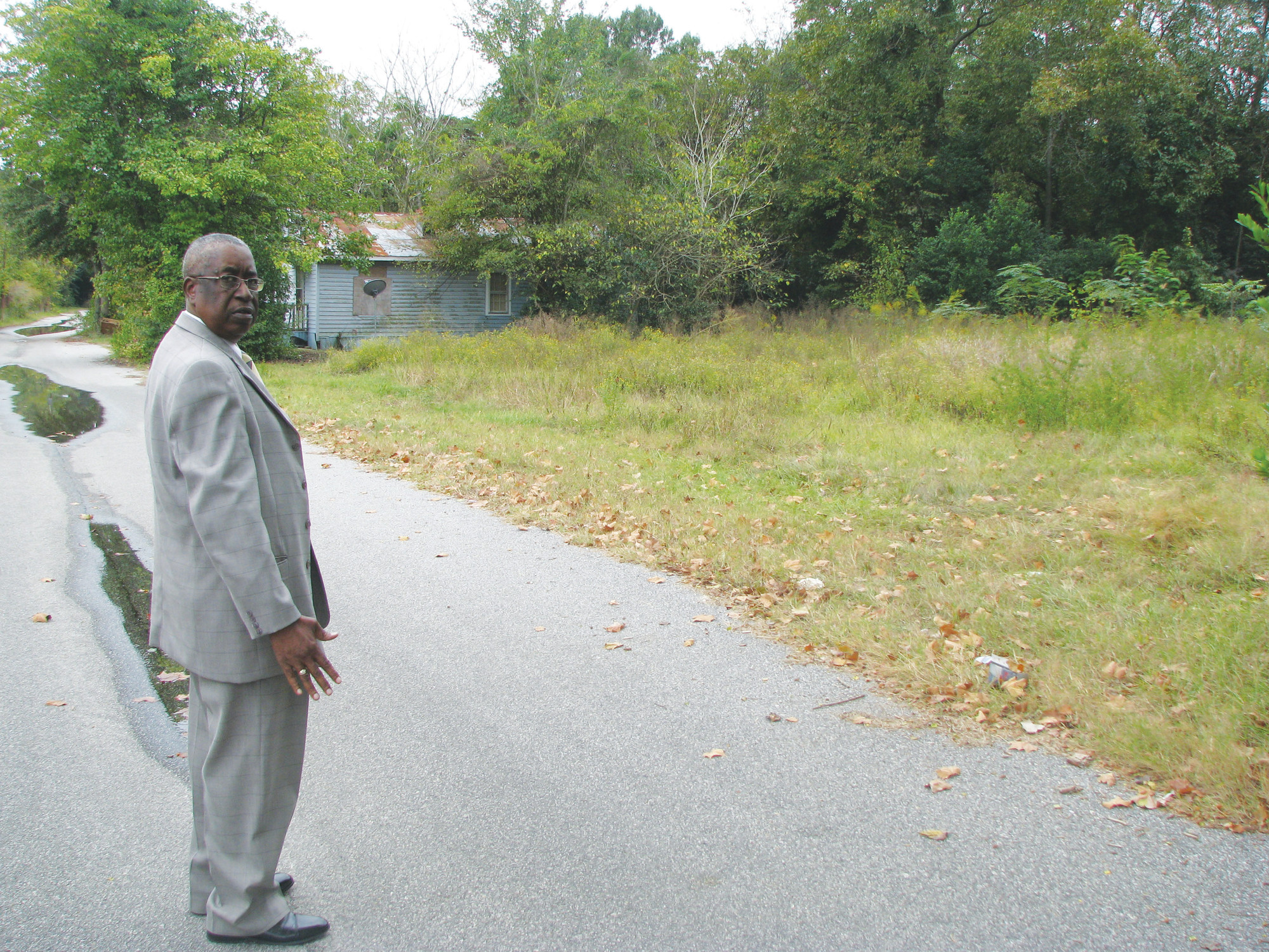 In 2012, First Sgt. Gene Williams, with Sumter Police Department, stands along the stretch of Northwestern Avenue where the body of Pamela Gregg was found nine years earlier.