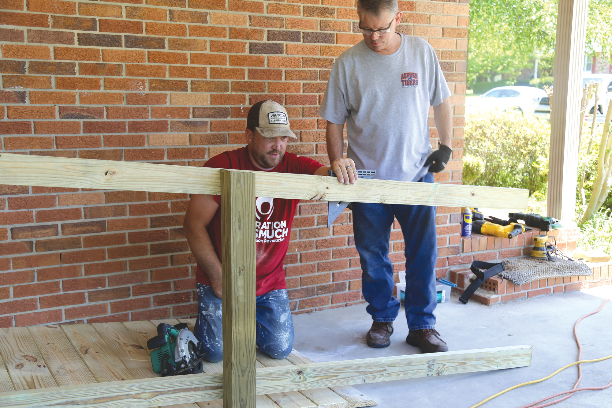 Brandon Wharton, left, works on a new wheelchair ramp with Doug Gant on Saturday at Cynthia Bell's home as part of Alice Drive Baptist Church's Operation Inasmuch.