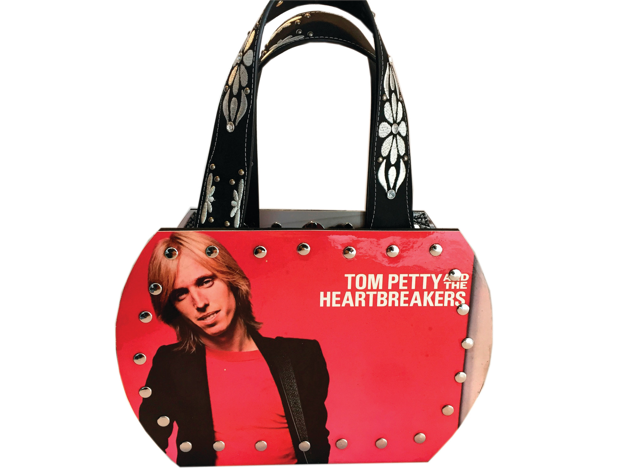 Seen is a purse made from a vinyl record and its album cover by Jennifer Wozniak.