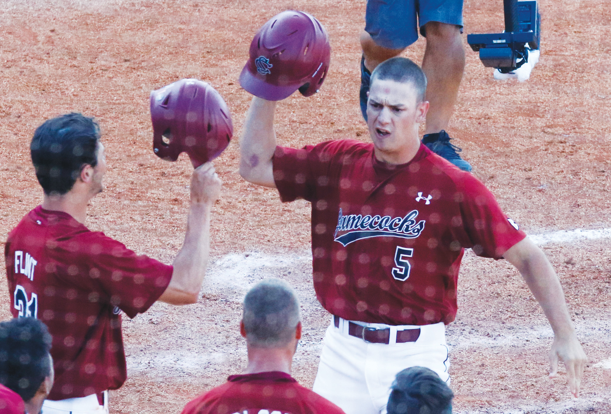 FILE - In this May 26, 2017, file photo, South Carolina's TJ Hopkins (5) celebrates with teammates after hitting a three-run home run during the seventh inning of the Southeastern Conference NCAA college baseball tournament against Kentucky, in Hoover, Ala. Three weeks ago, South Carolina was a team in free fall and on the way to missing the postseason for the third time in four years. Now, the Gamecocks are one of the Southeastern Conference's hottest teams and making a late bid to host early r