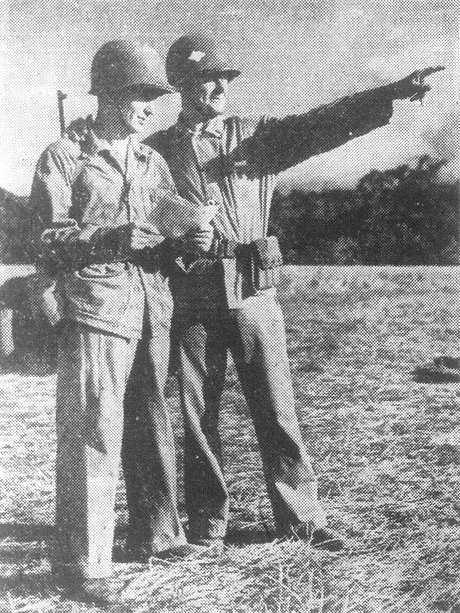 1943 - Somewhere in the South Pacific, Capt. B.O. Cantey Jr. of Sumter and Chief Marine Gunner Laurie P. Mallard of California are seen in the field. Both were officers in a Marine artillery outfit.